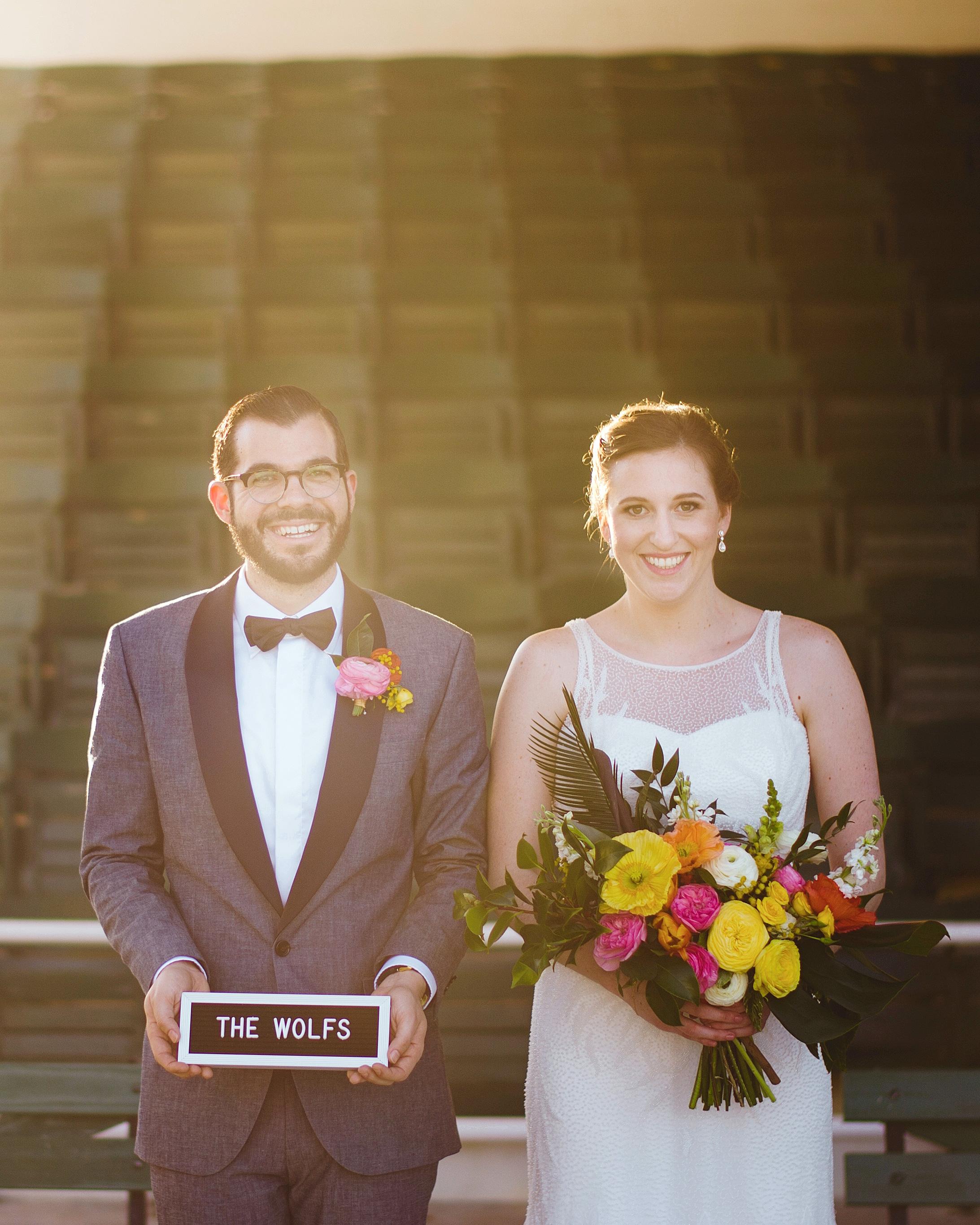 becca zac wedding couple with sign