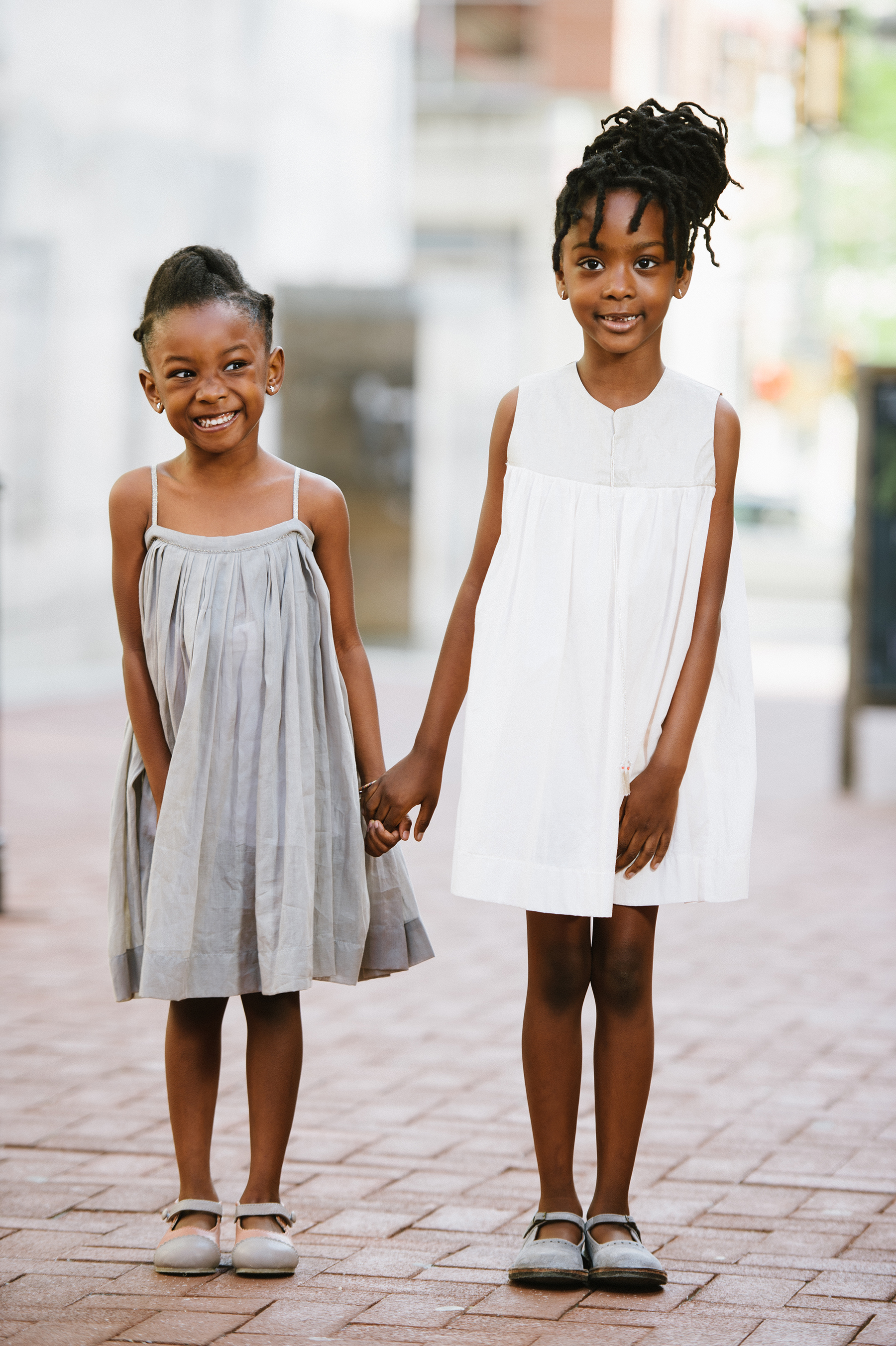 Flower Girl Hairstyle Side Twists and Braided Bun