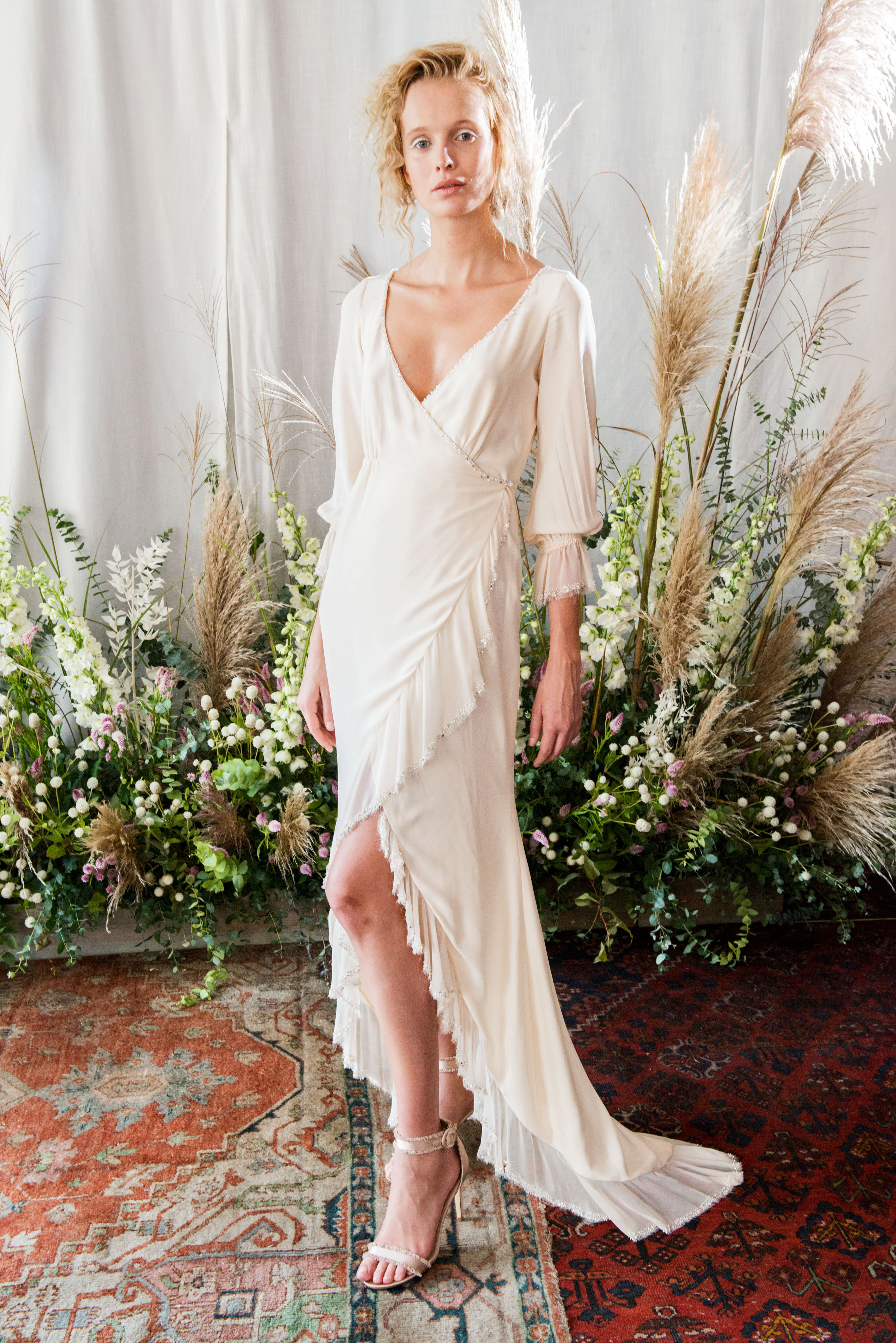 alexandra grecco wedding dress fall 2018 off white wrap high low three-quarter sleeves