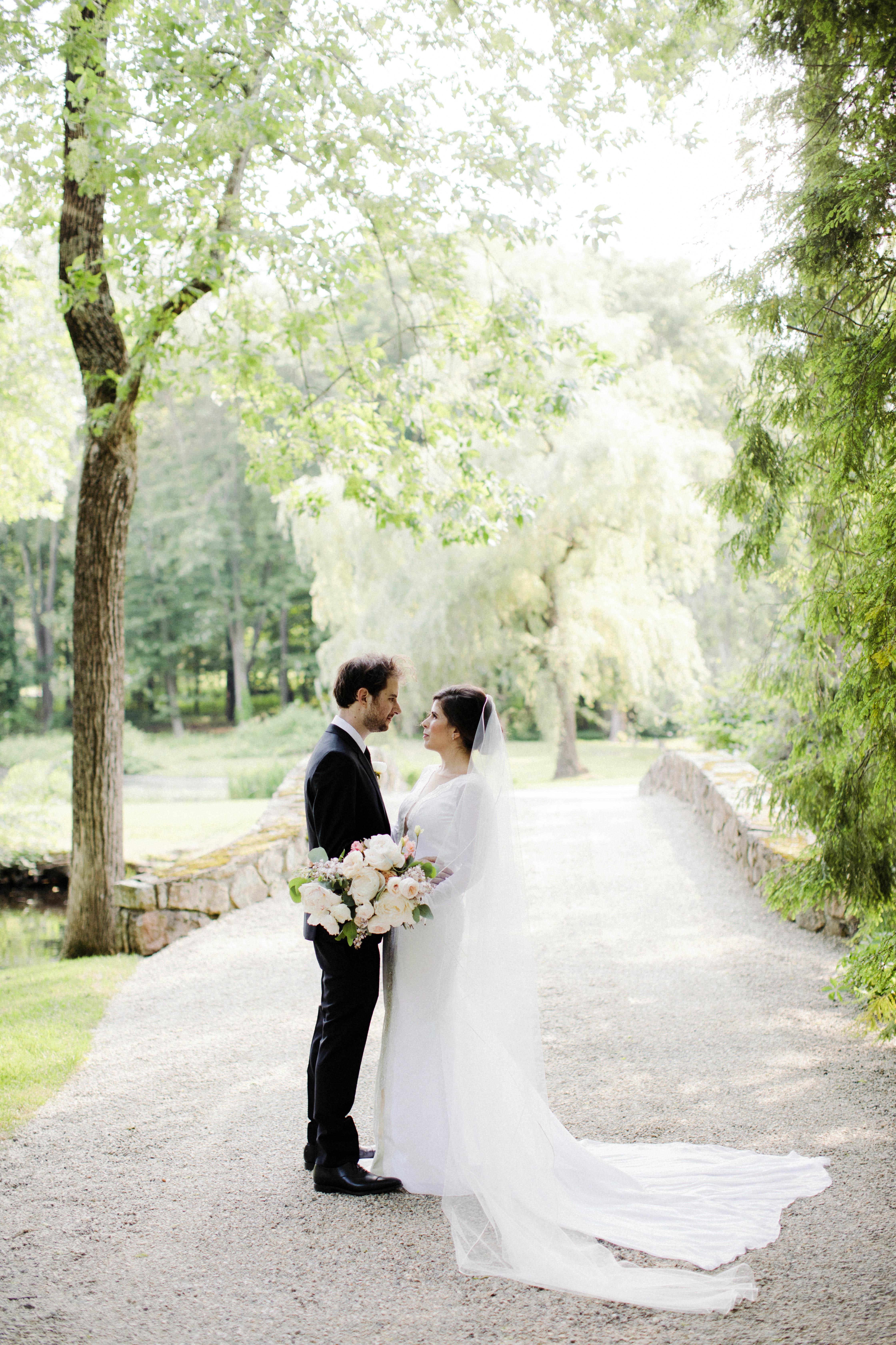 eden jack wedding couple facing each other