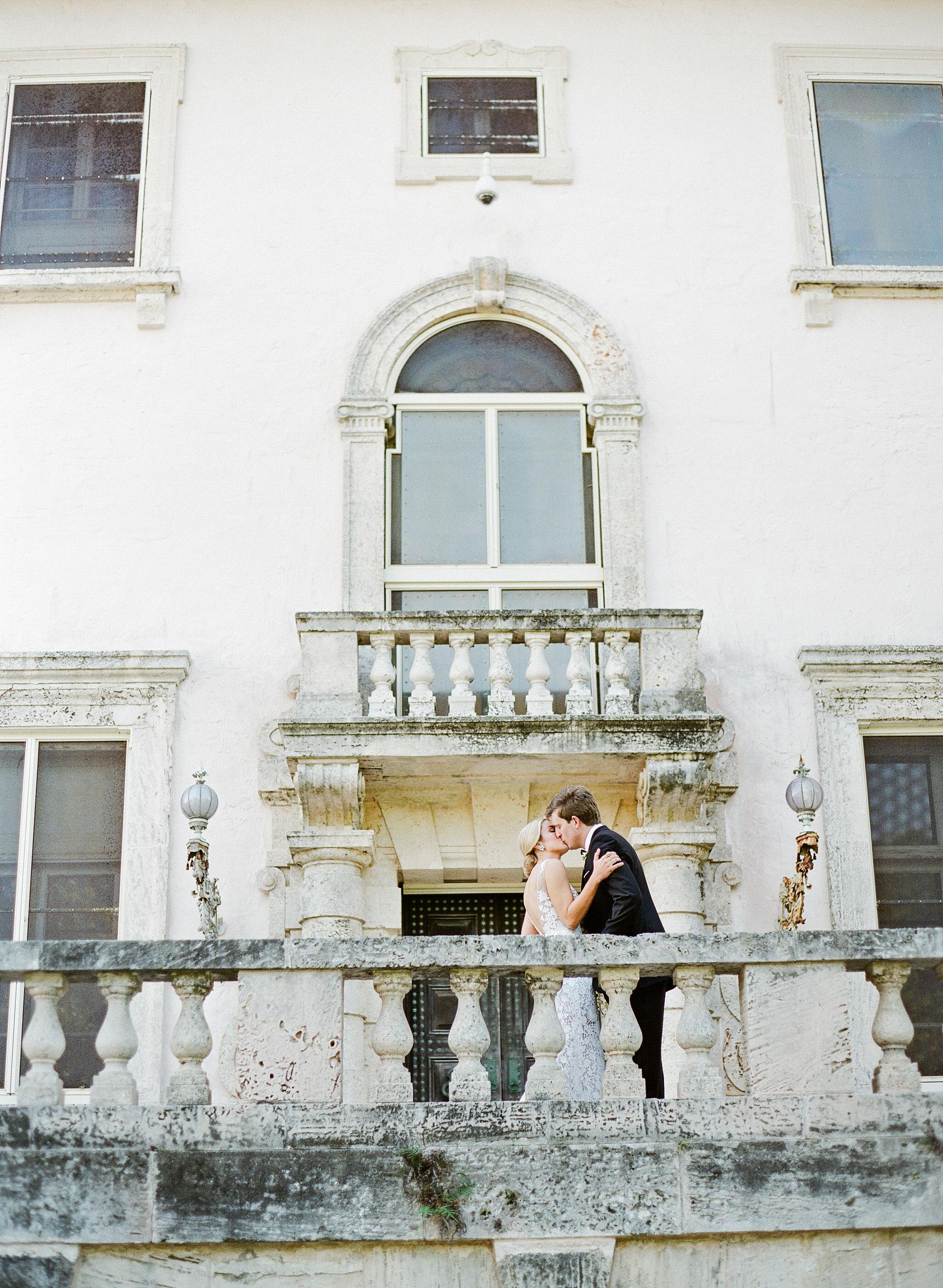 natalie jamey wedding couple balcony kiss
