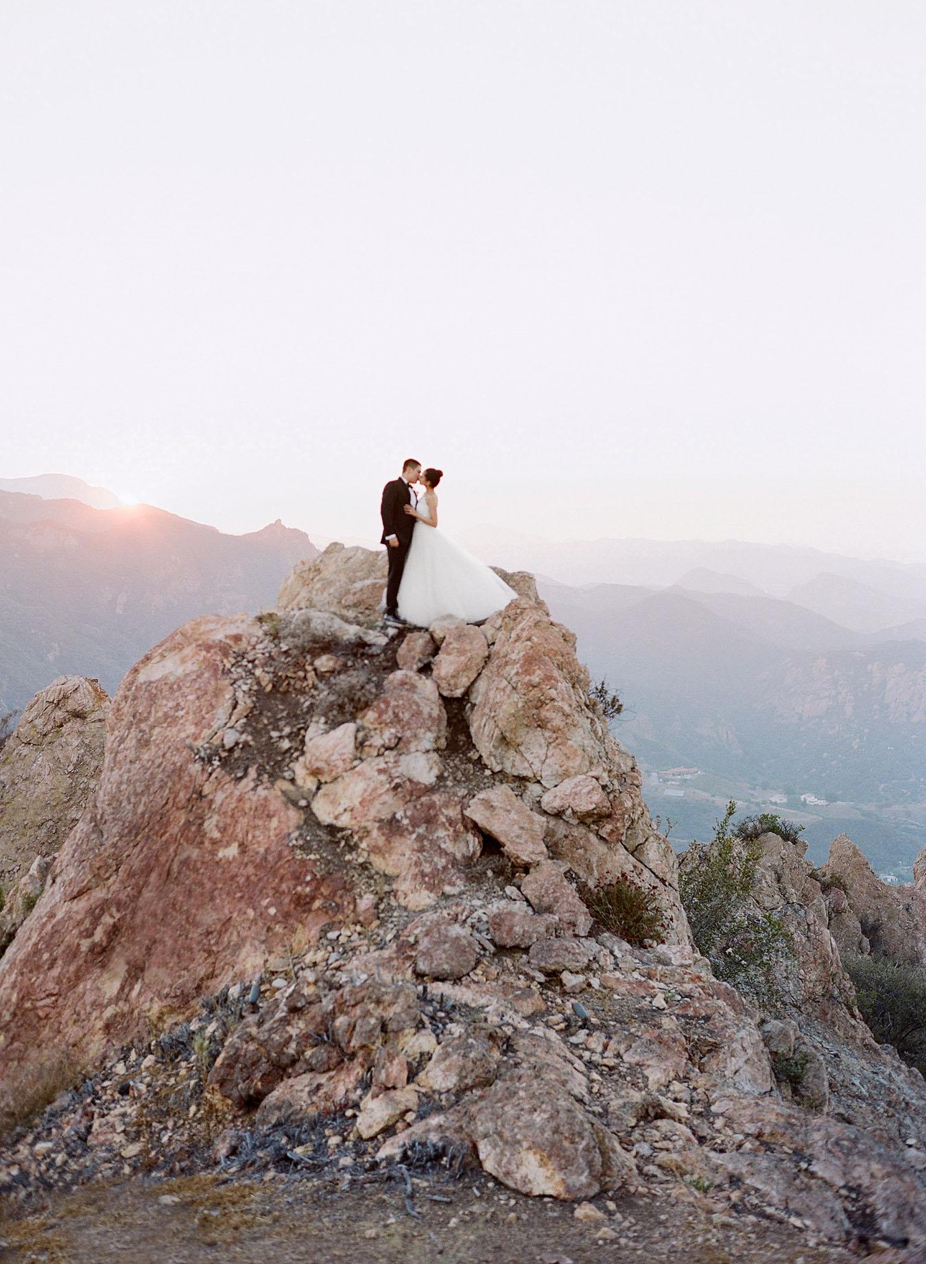 aislinn eric wedding malibu bride groom kissing rocks