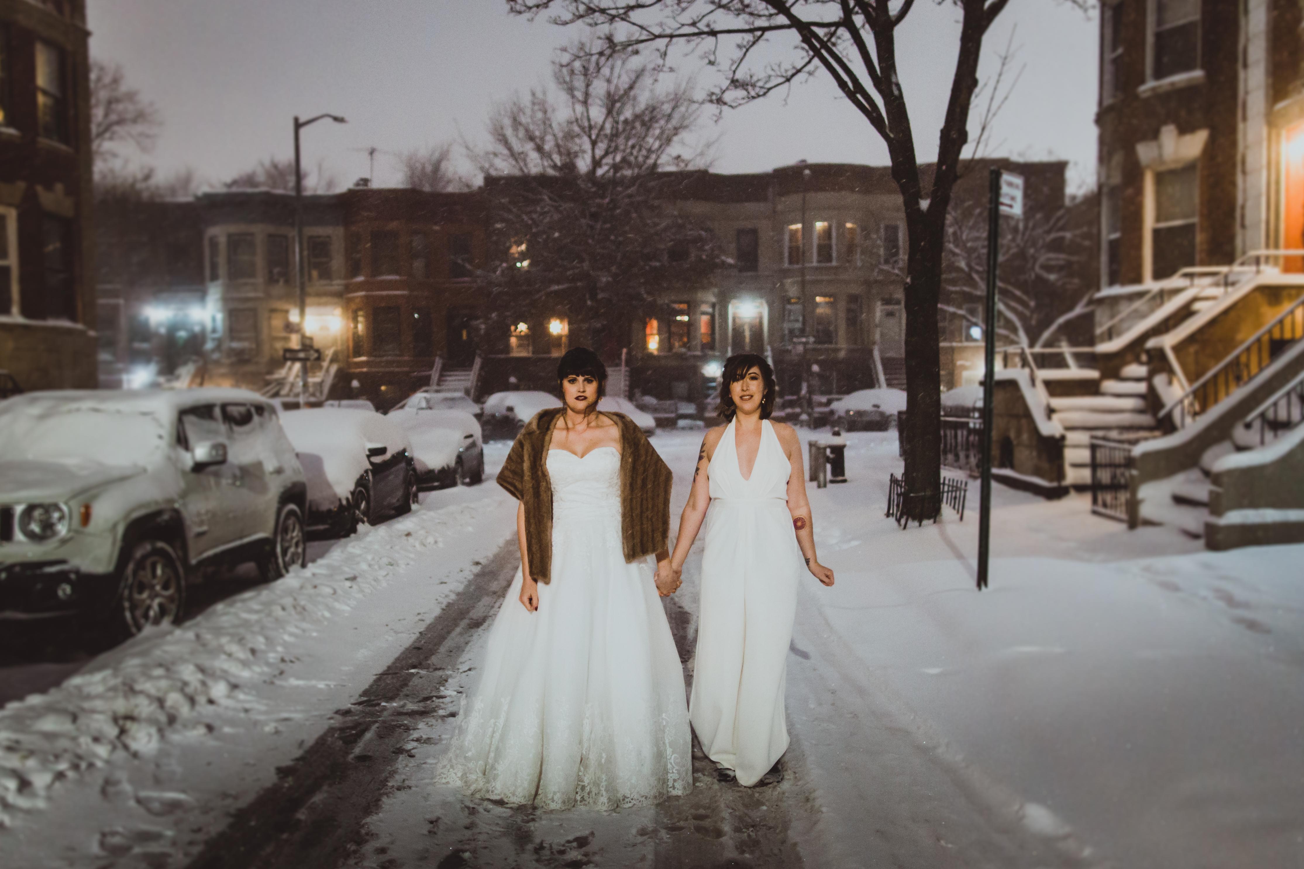 brides on snowy street