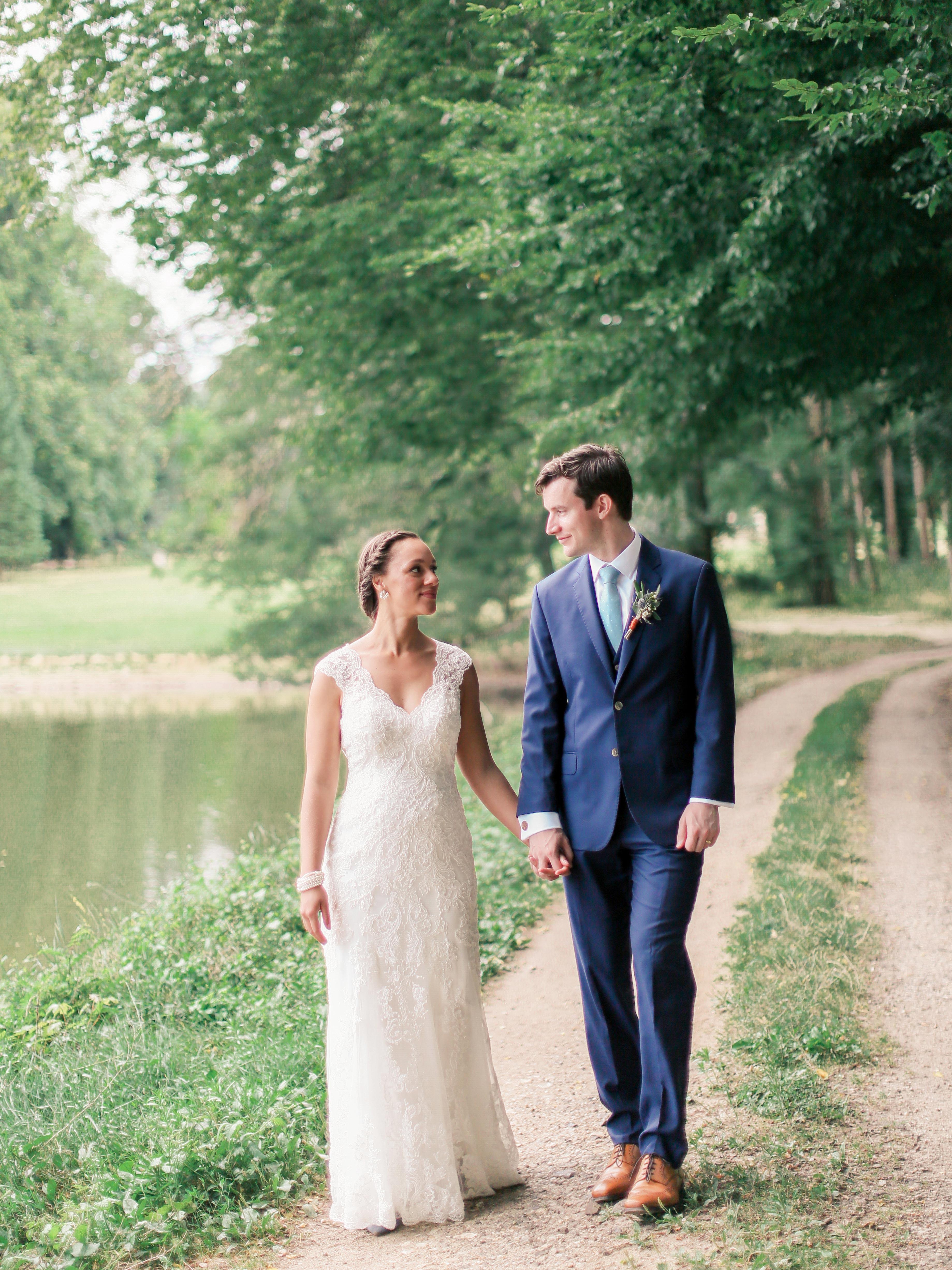 wedding couple walking pond