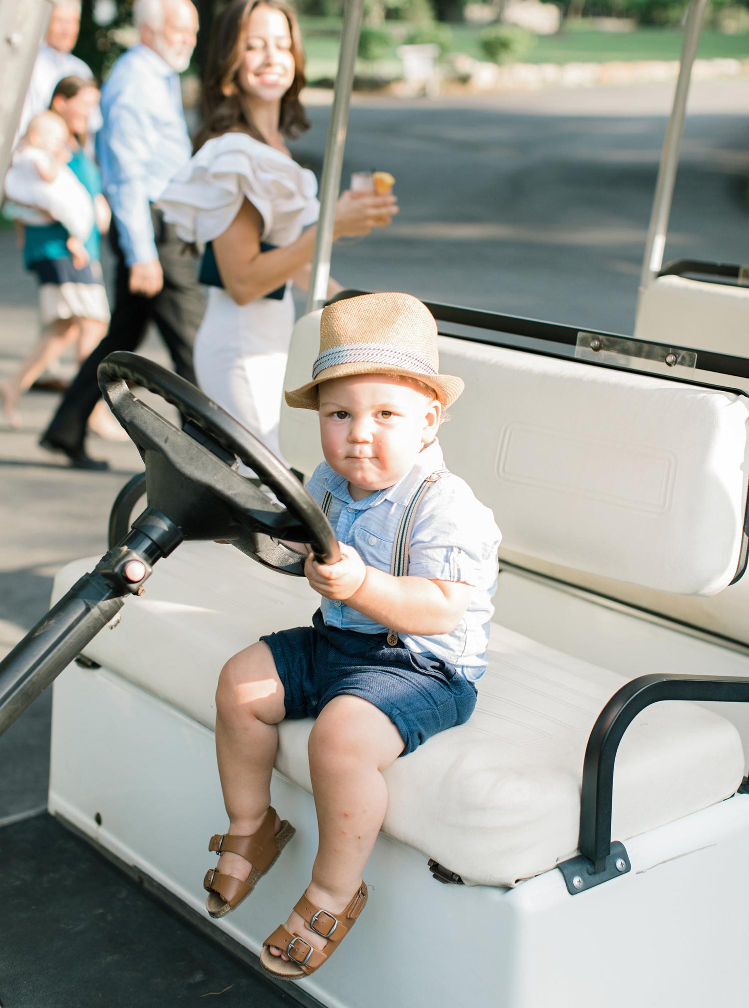 camryn eugene boy in golf cart