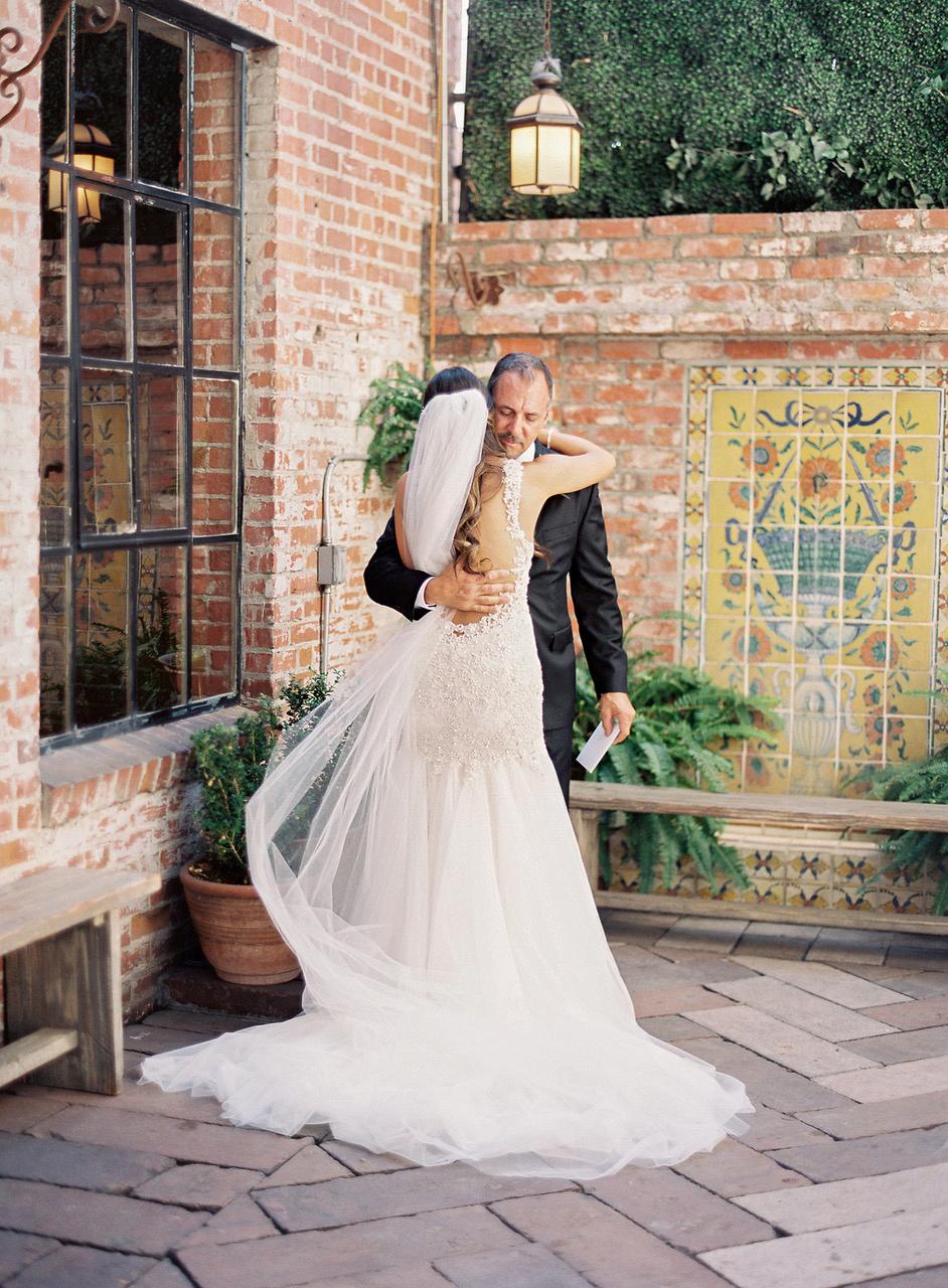 bride and father hug outside