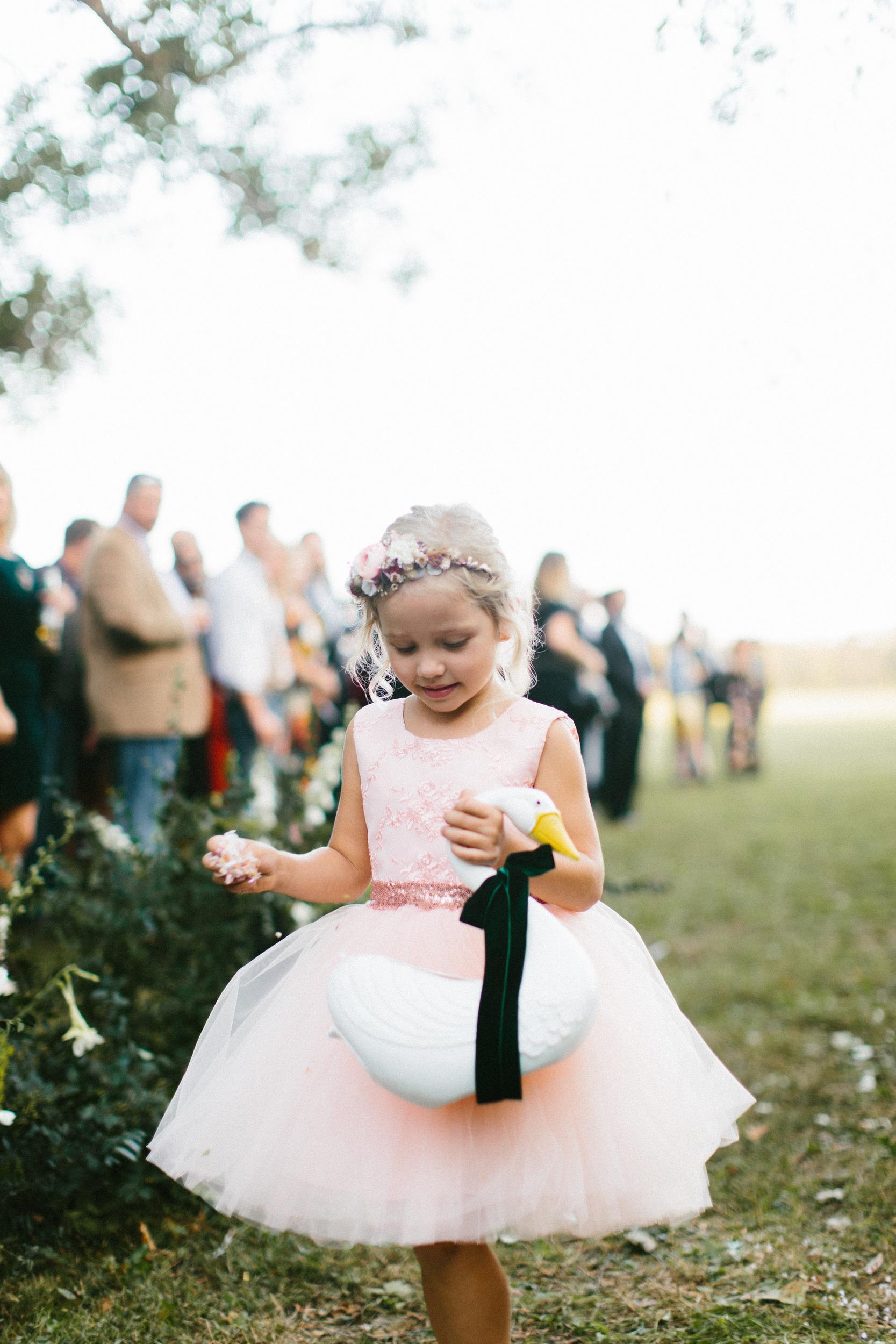 flower girl throwing petals