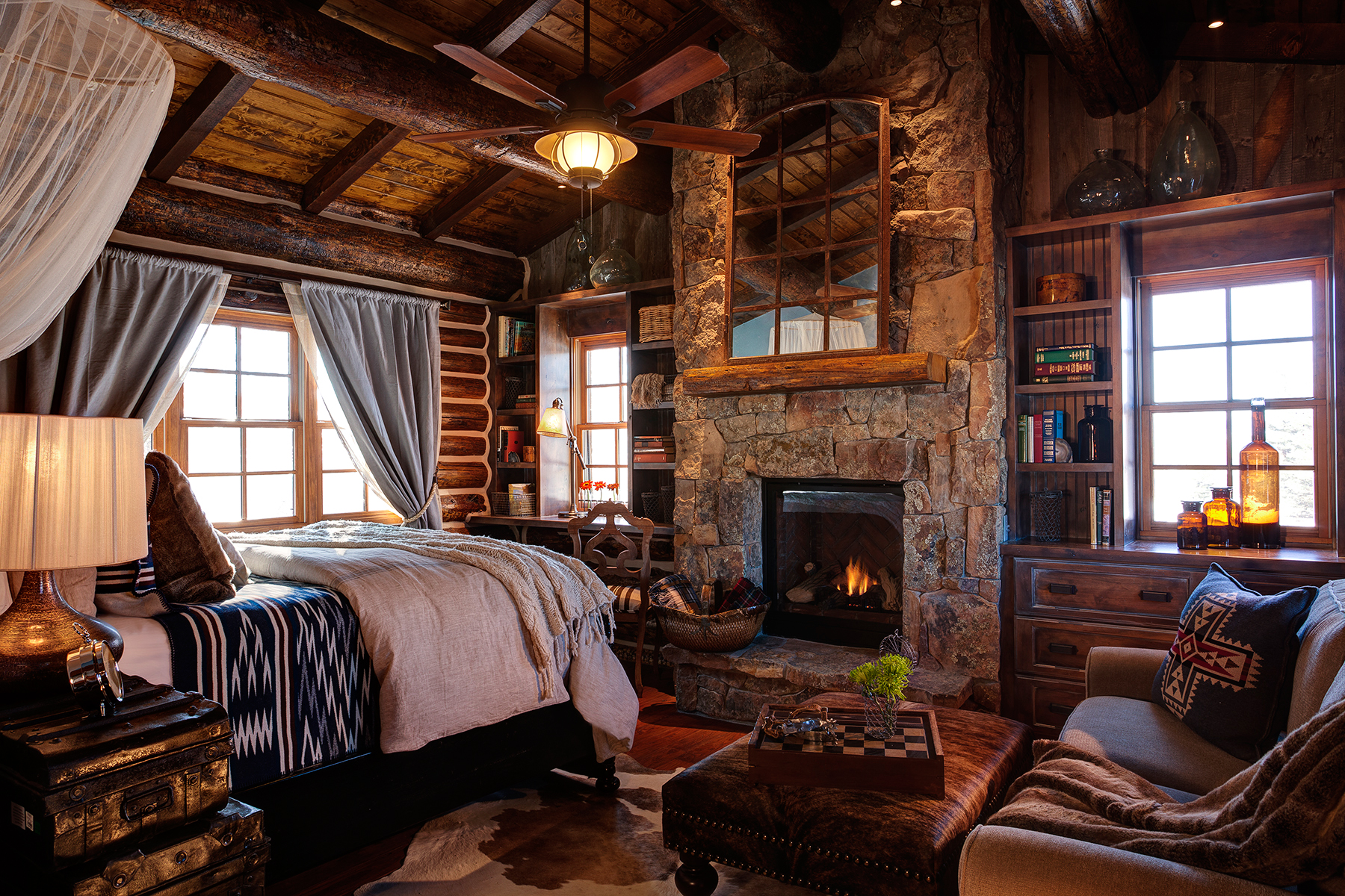 dude ranch honeymoon magee brush creek cabin interior bed fireplace