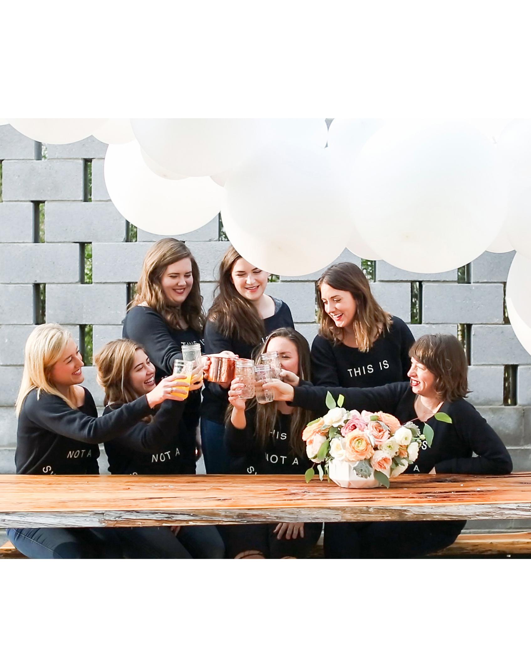 bridal shower girls toasting