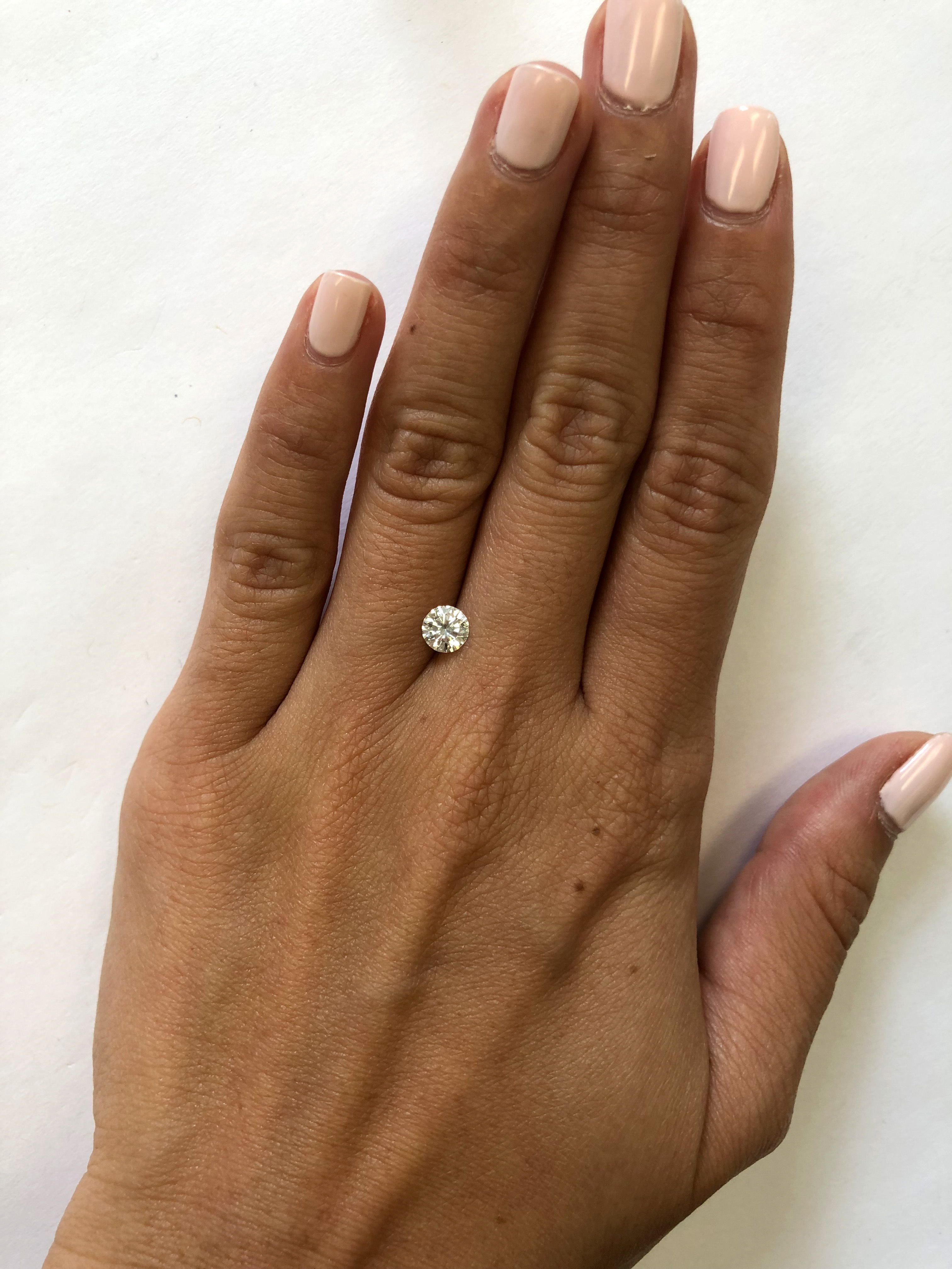 hand with half carat diamond