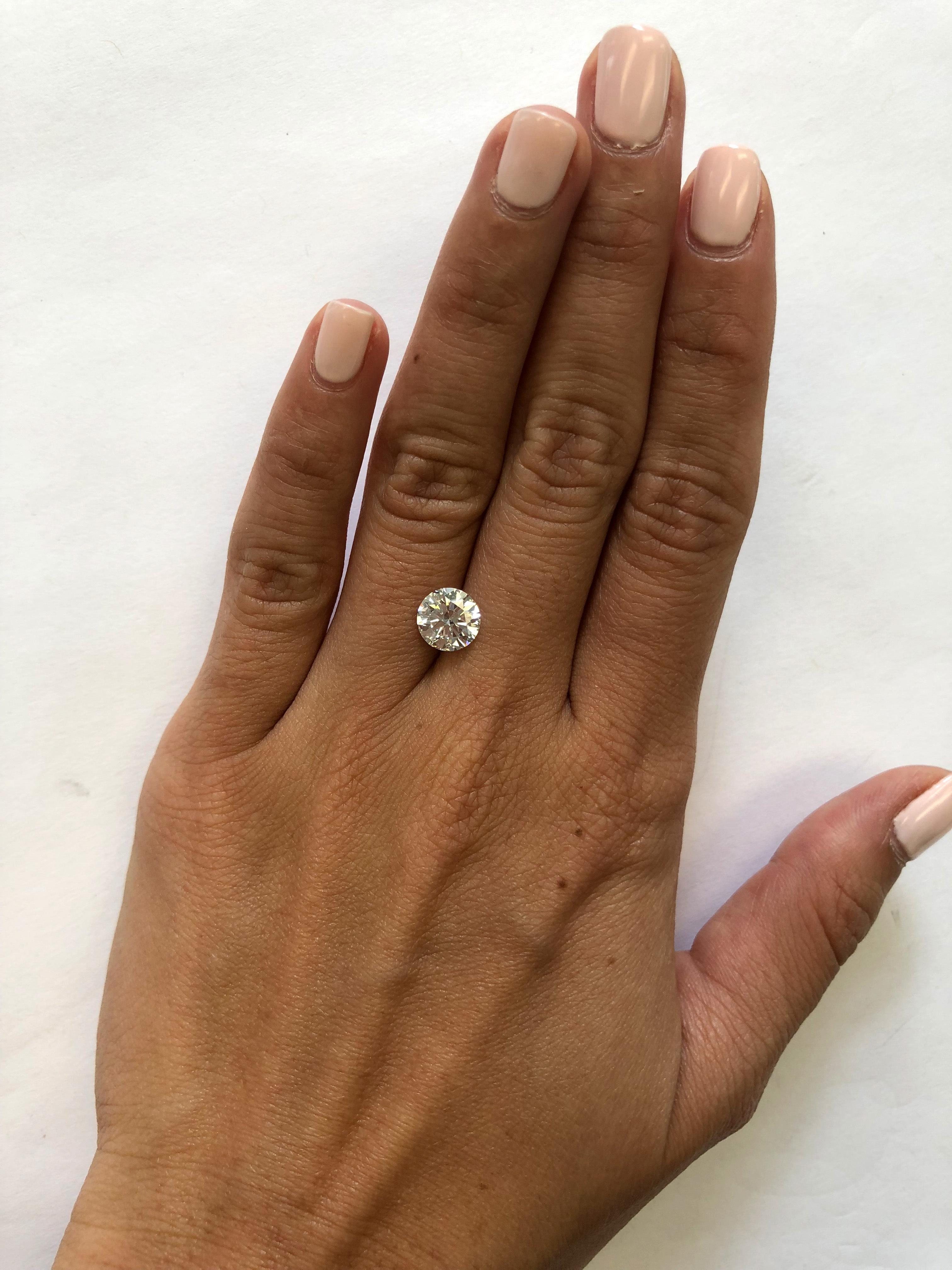 hand with 1.5 carat diamond