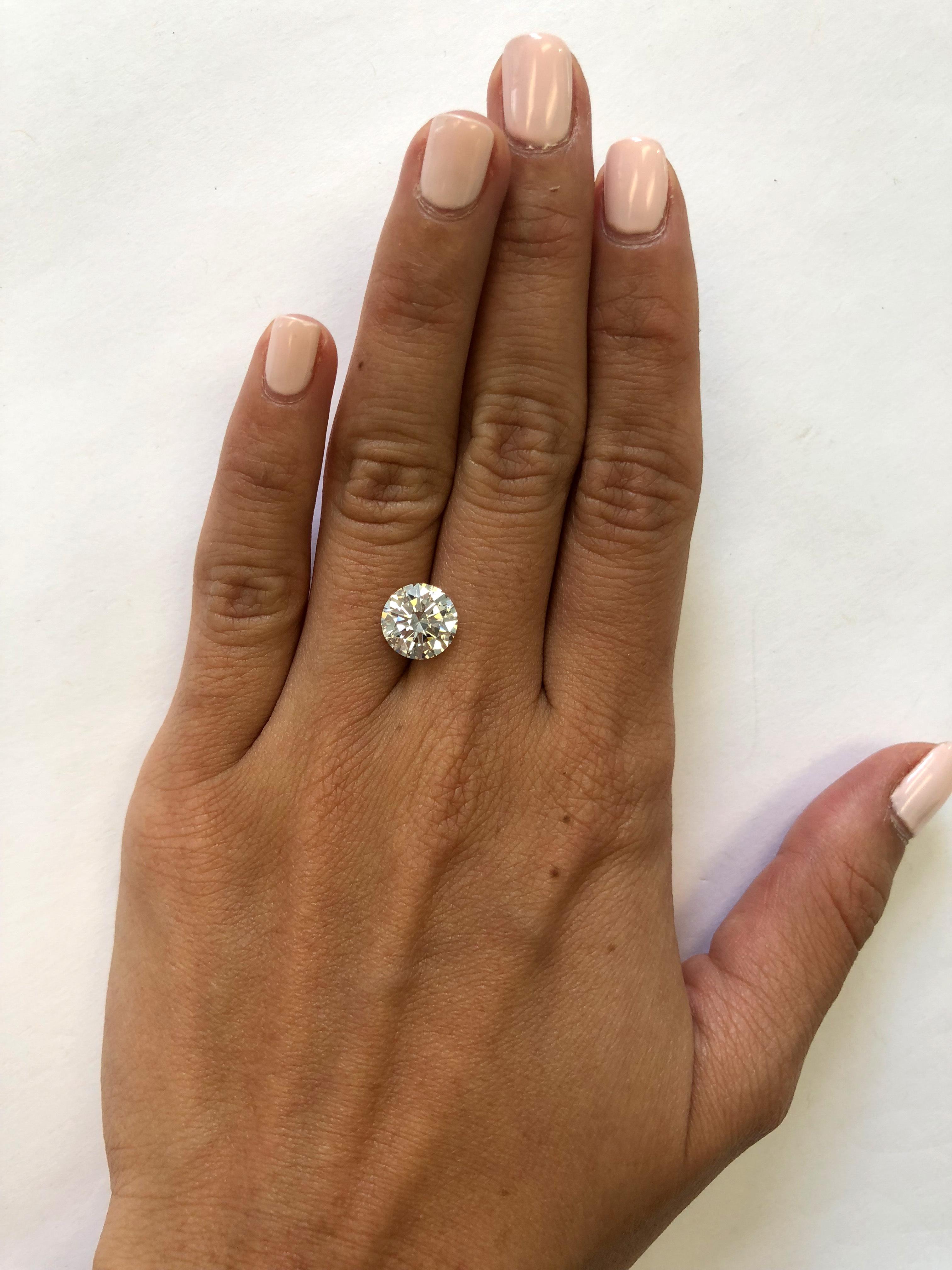 hand with 2.5 carat diamond
