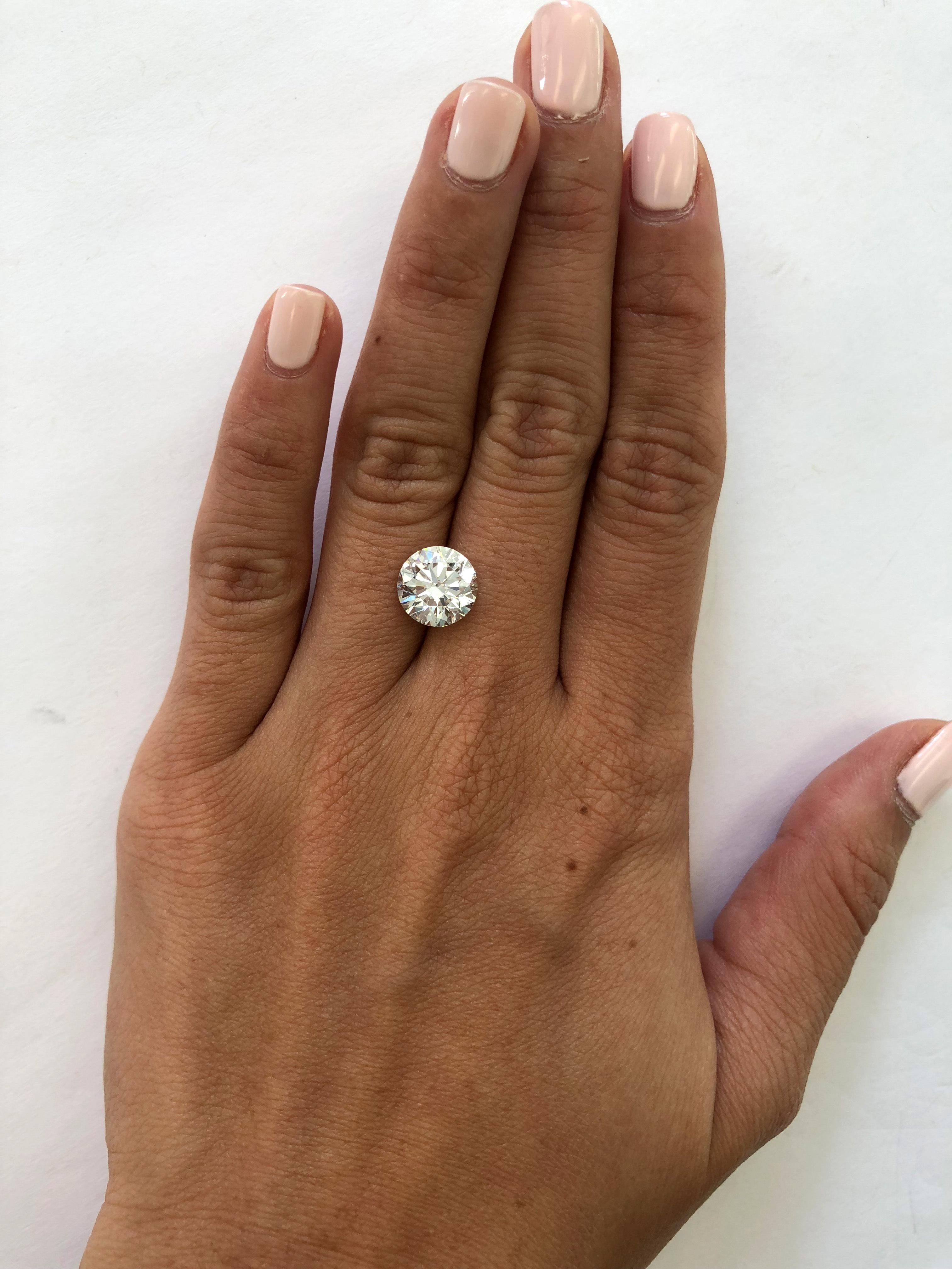 hand with 3 carat diamond