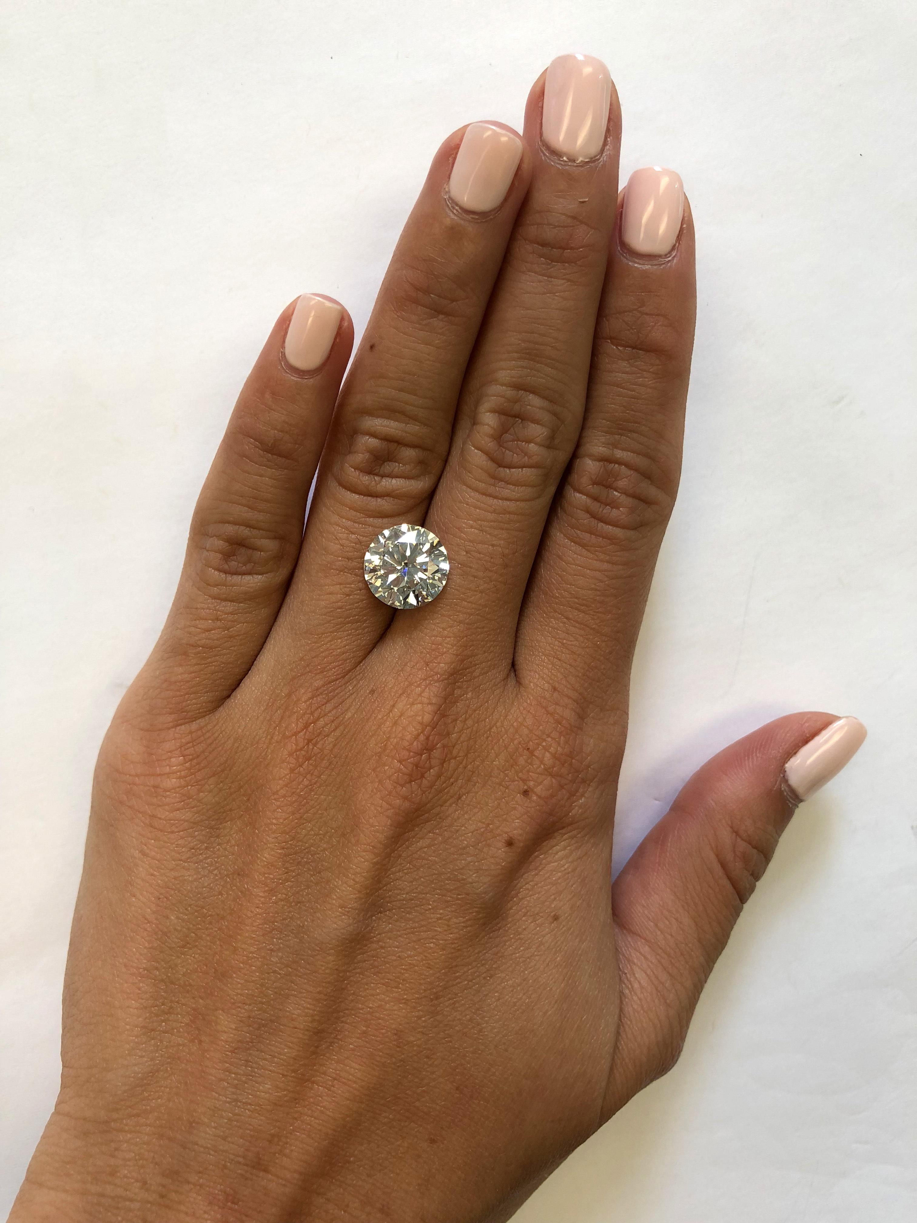 hand with 4 carat diamond
