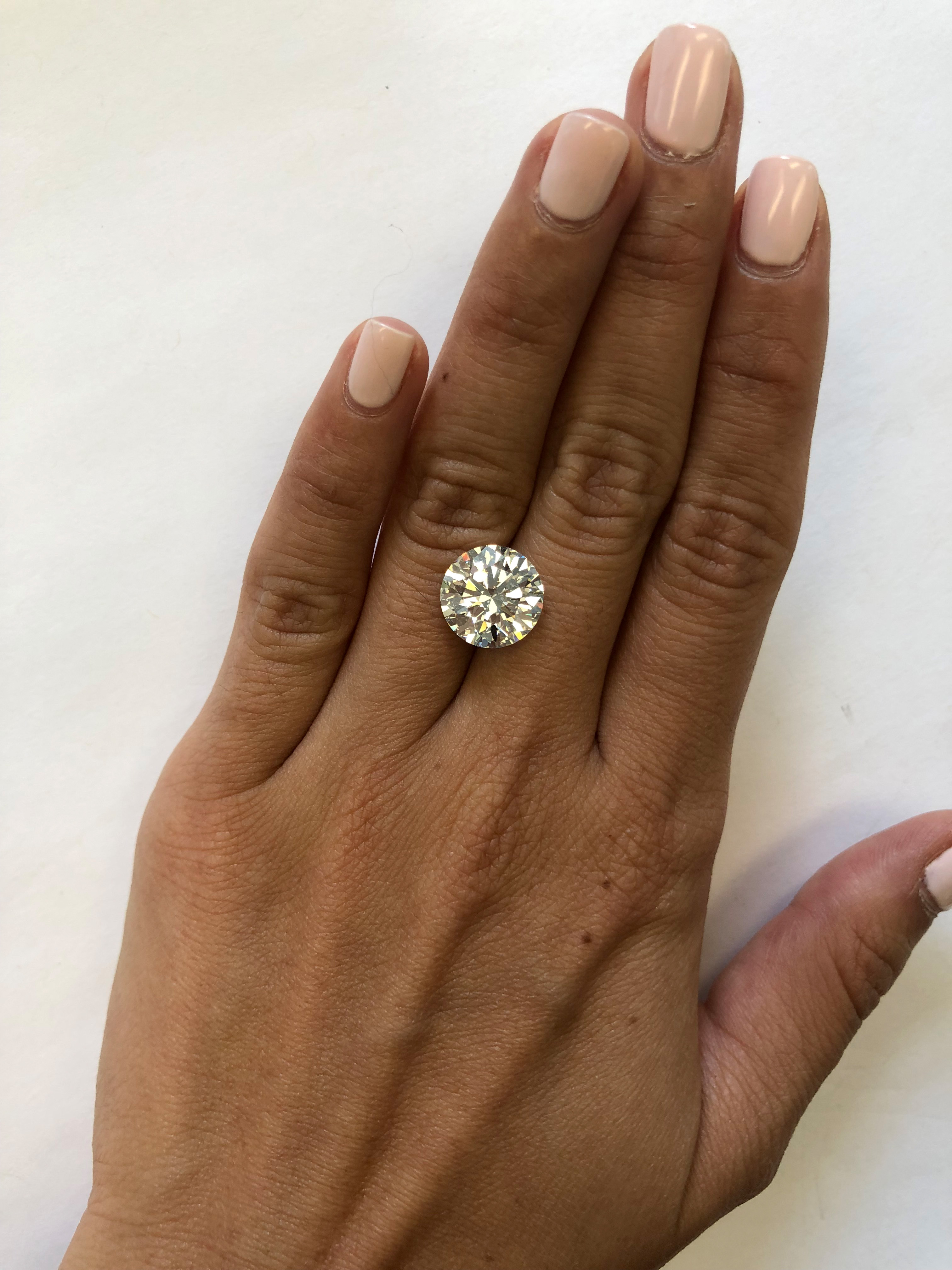hand with 5 carat diamond