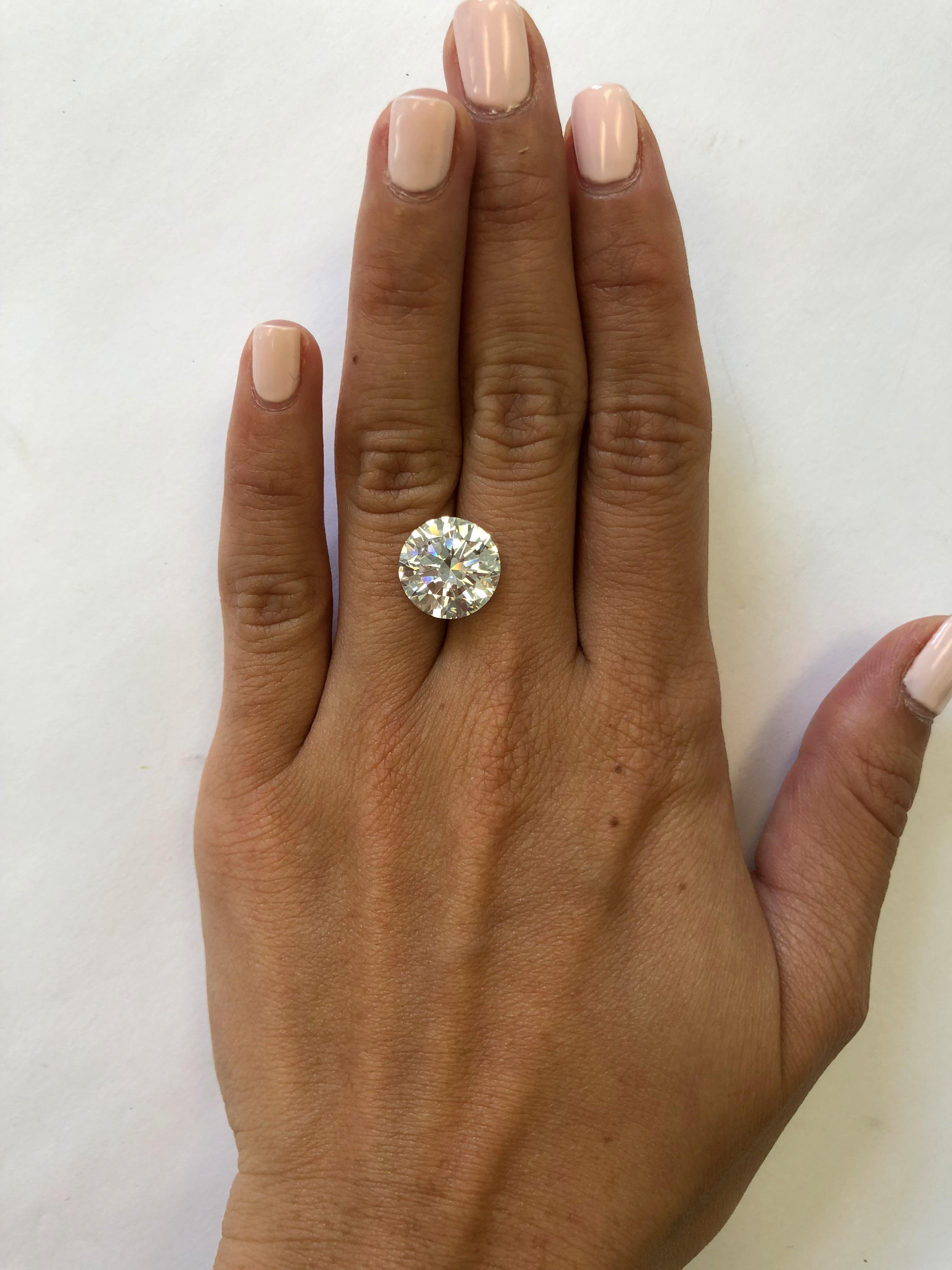 hand with 6 carat diamond
