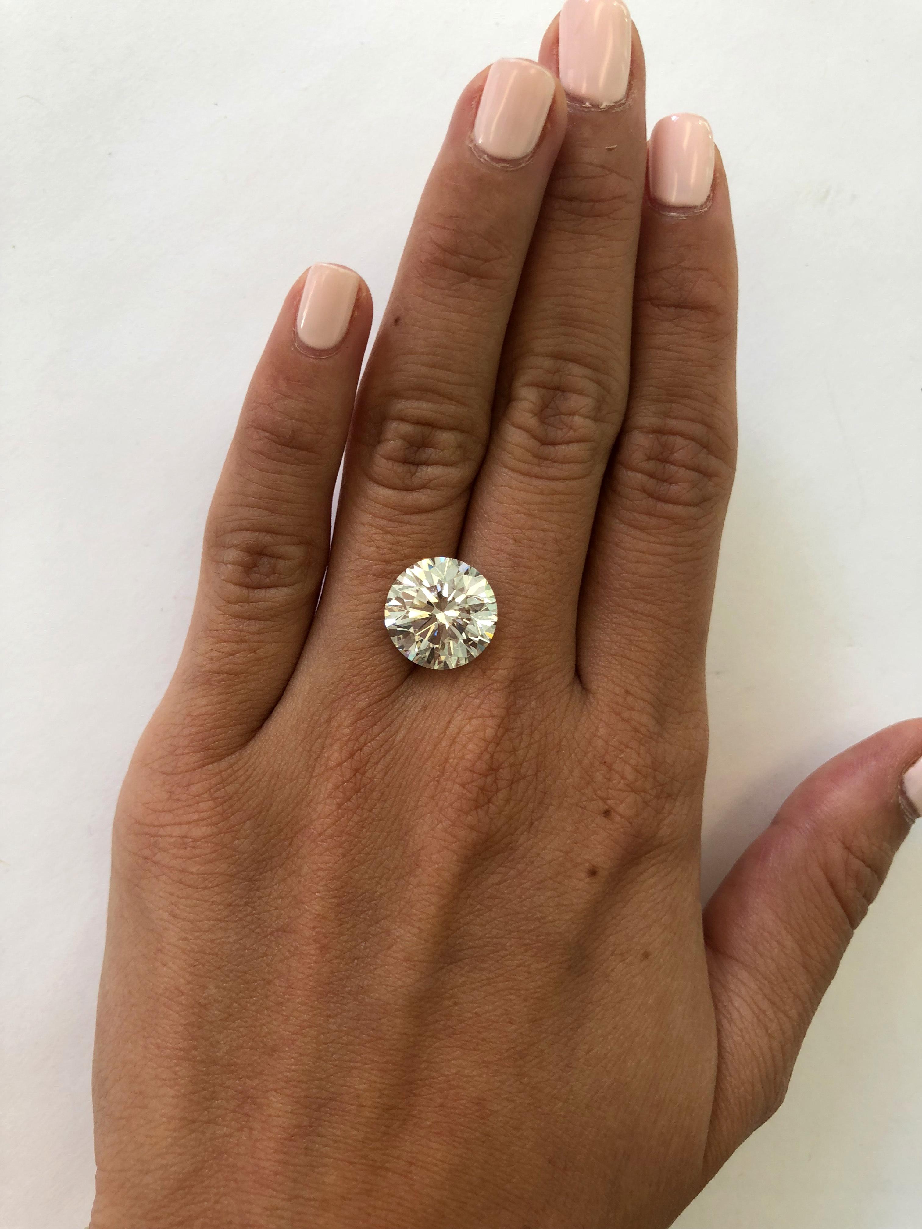 hand with 7 carat diamond