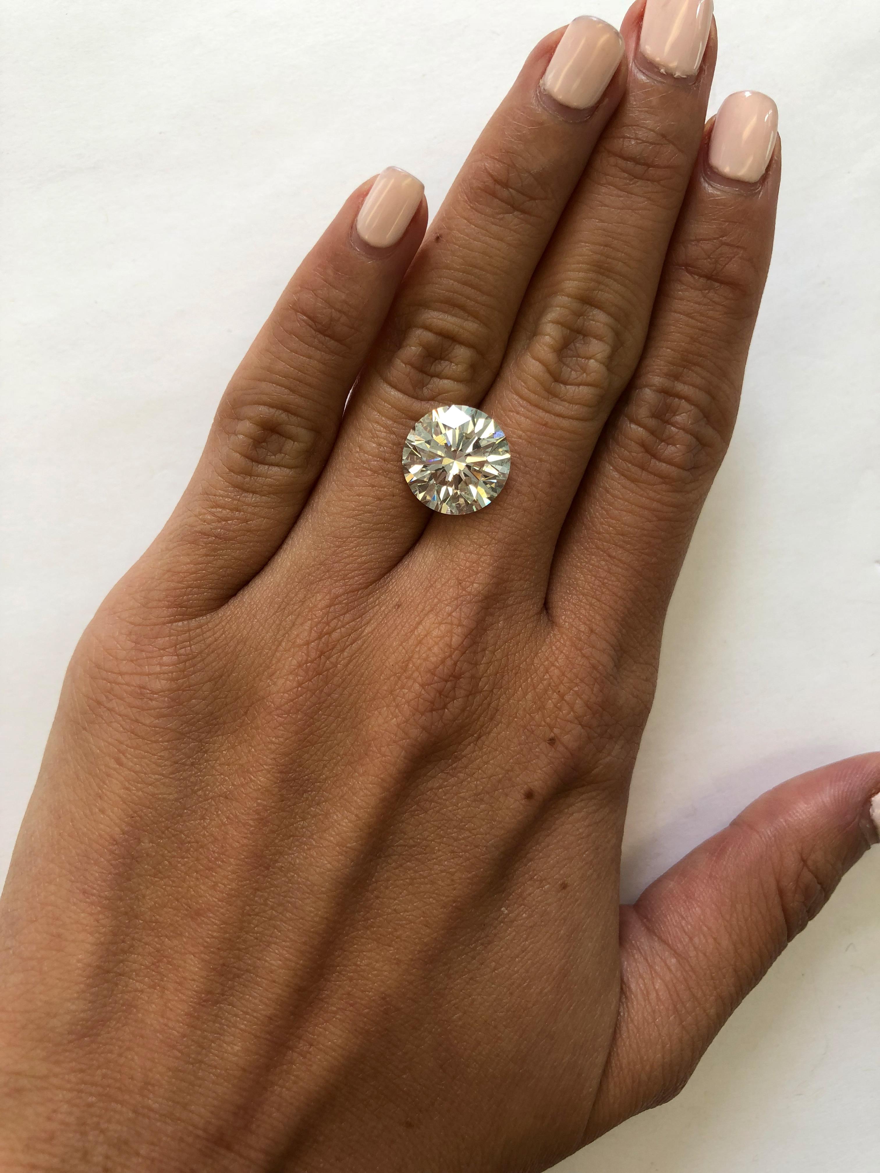 hand with 8 carat diamond
