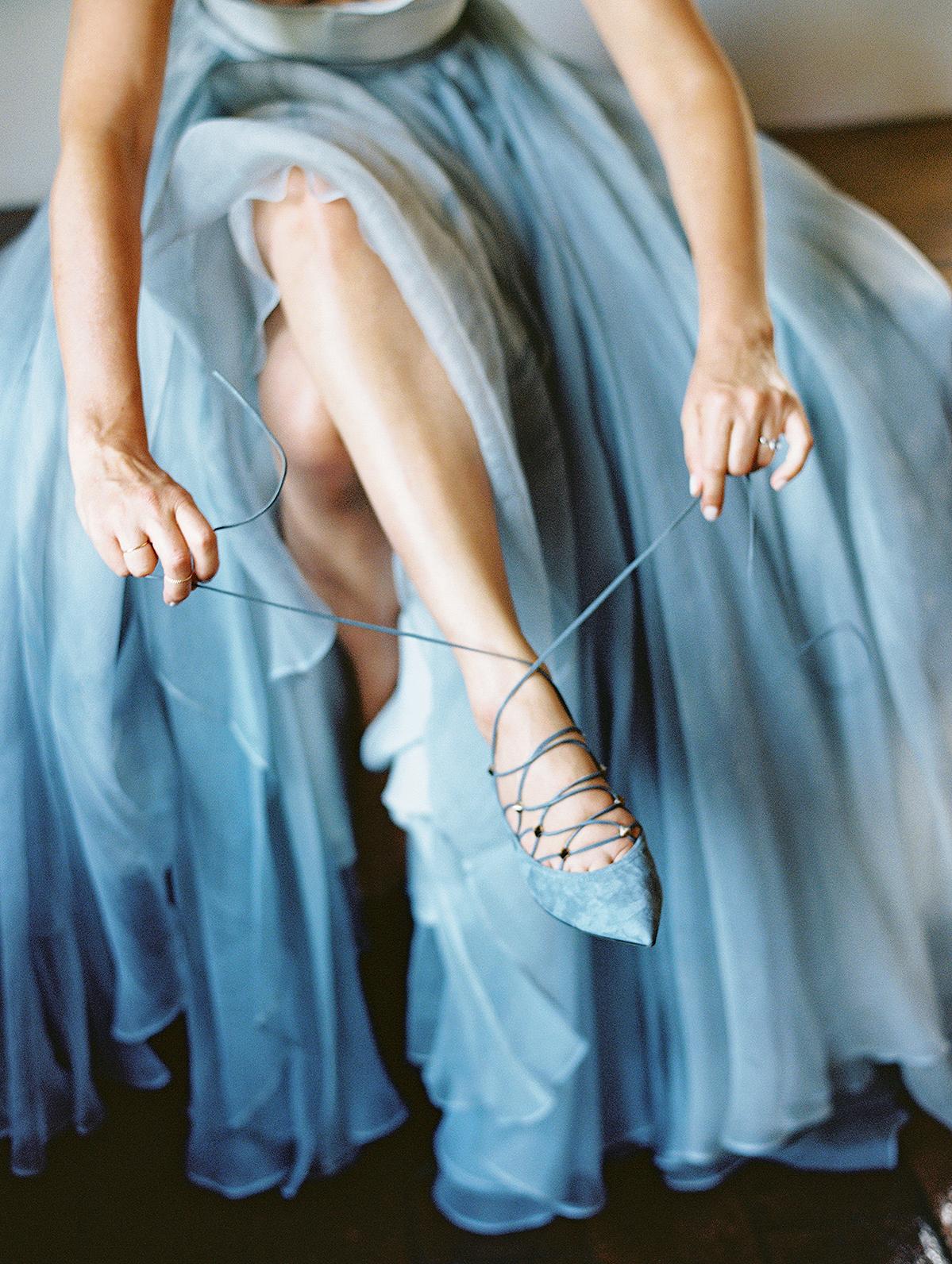 kelly pete wedding bride tying blue shoes