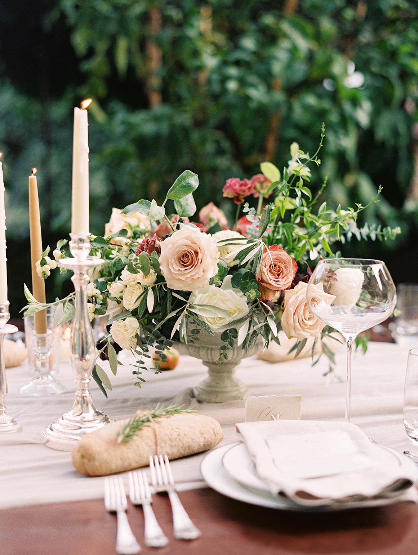 kelly pete wedding floral centerpiece in urn
