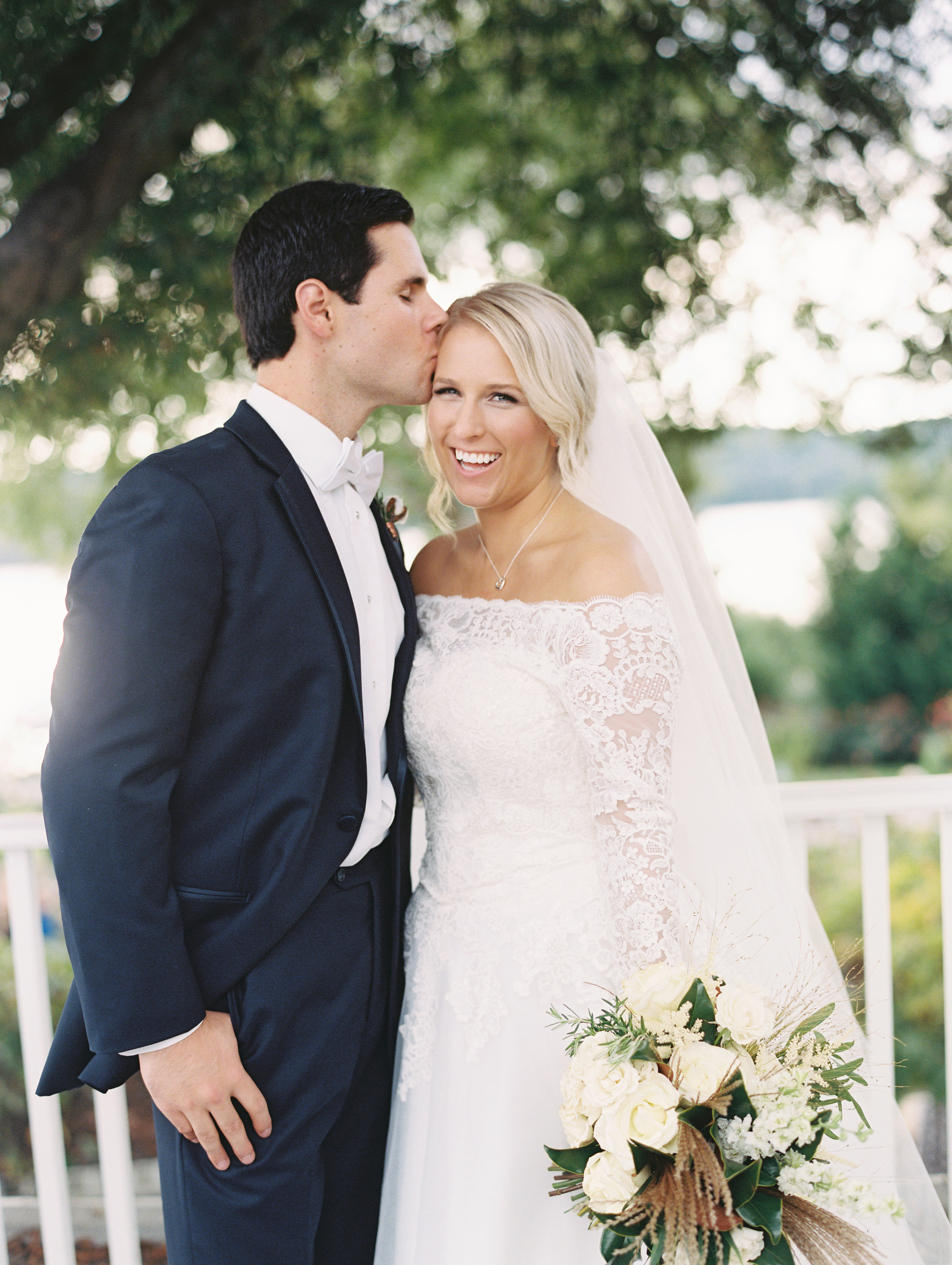 kendall nick wedding couple forehead kiss