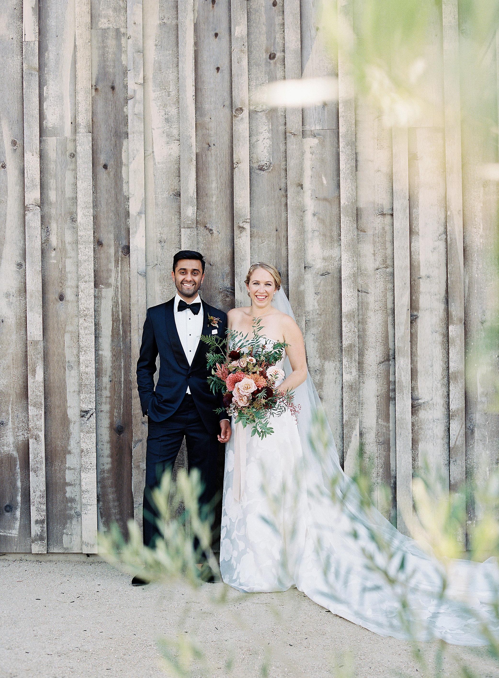 emily siddartha wedding couple bouquet barn