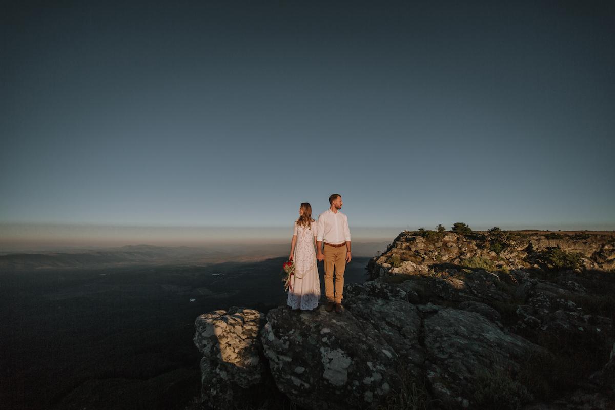 epic wedding photos megan ann couple on cliff