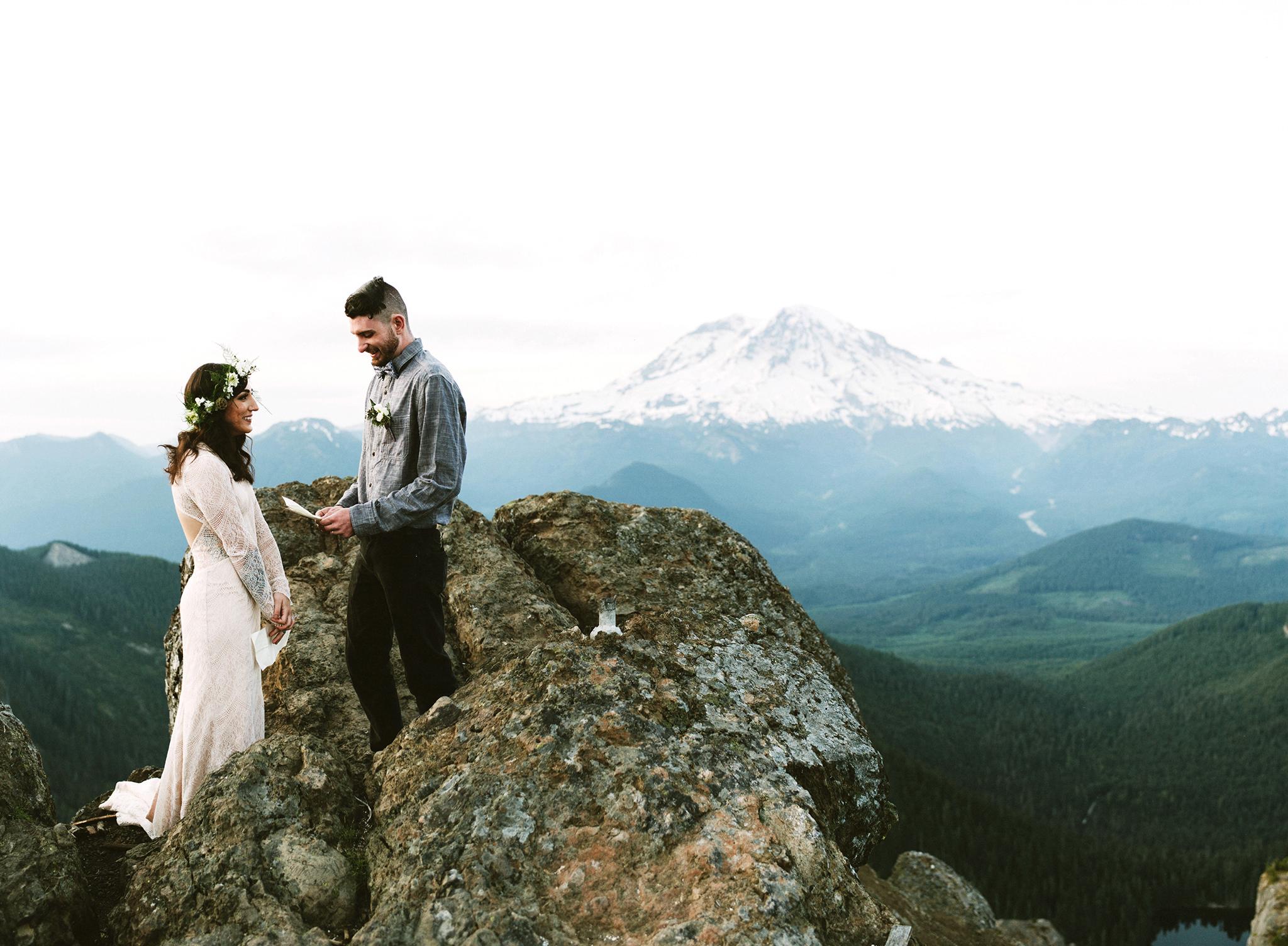 epic wedding photos benj haisch couple on cliff
