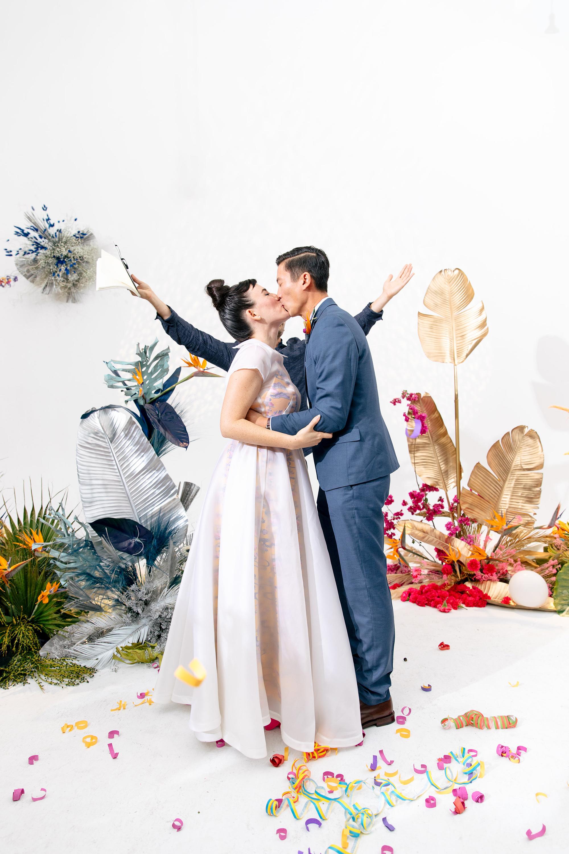 tashina huy colorful wedding ceremony kiss