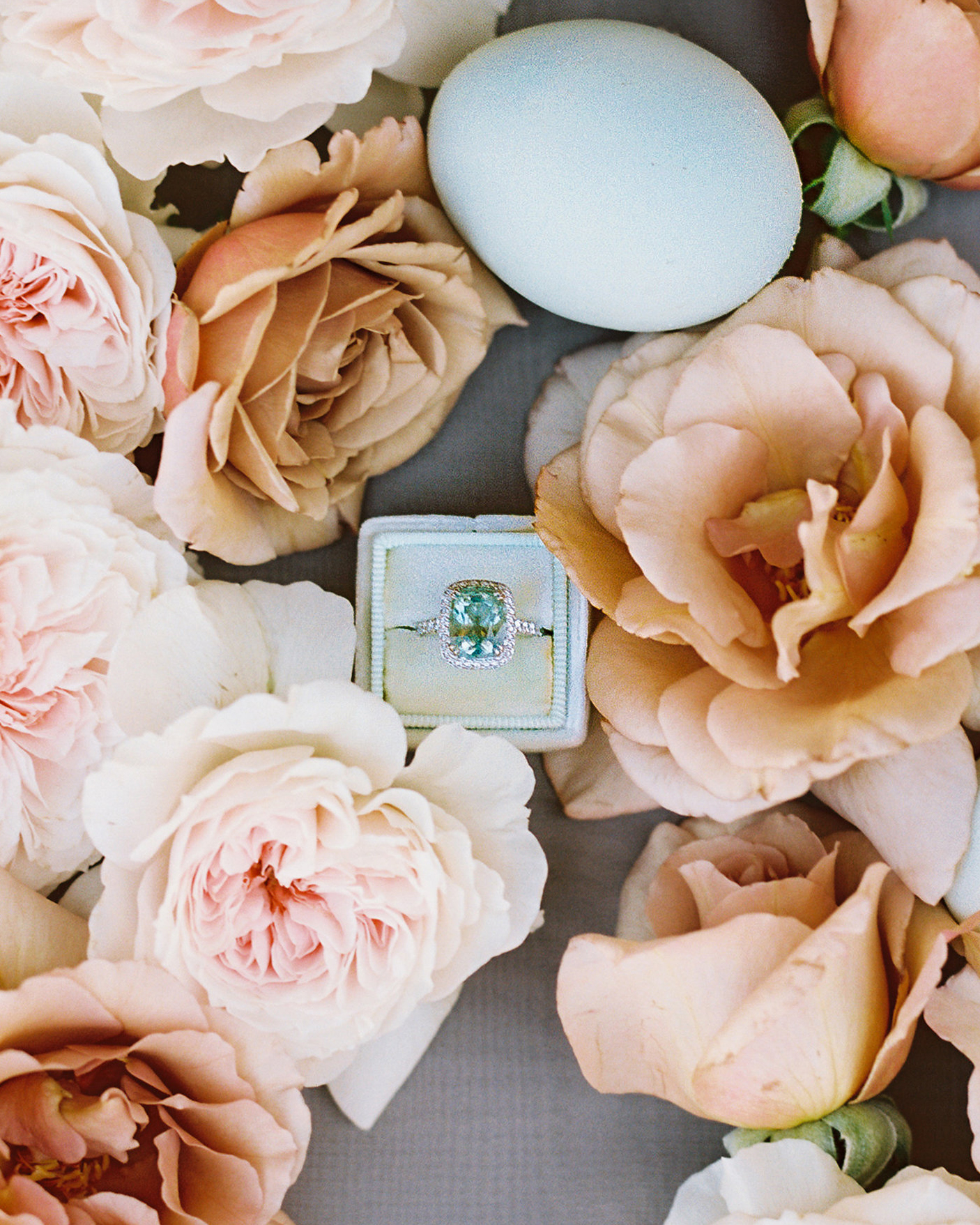 surprise wedding engagement ring surrounded by flowers egg