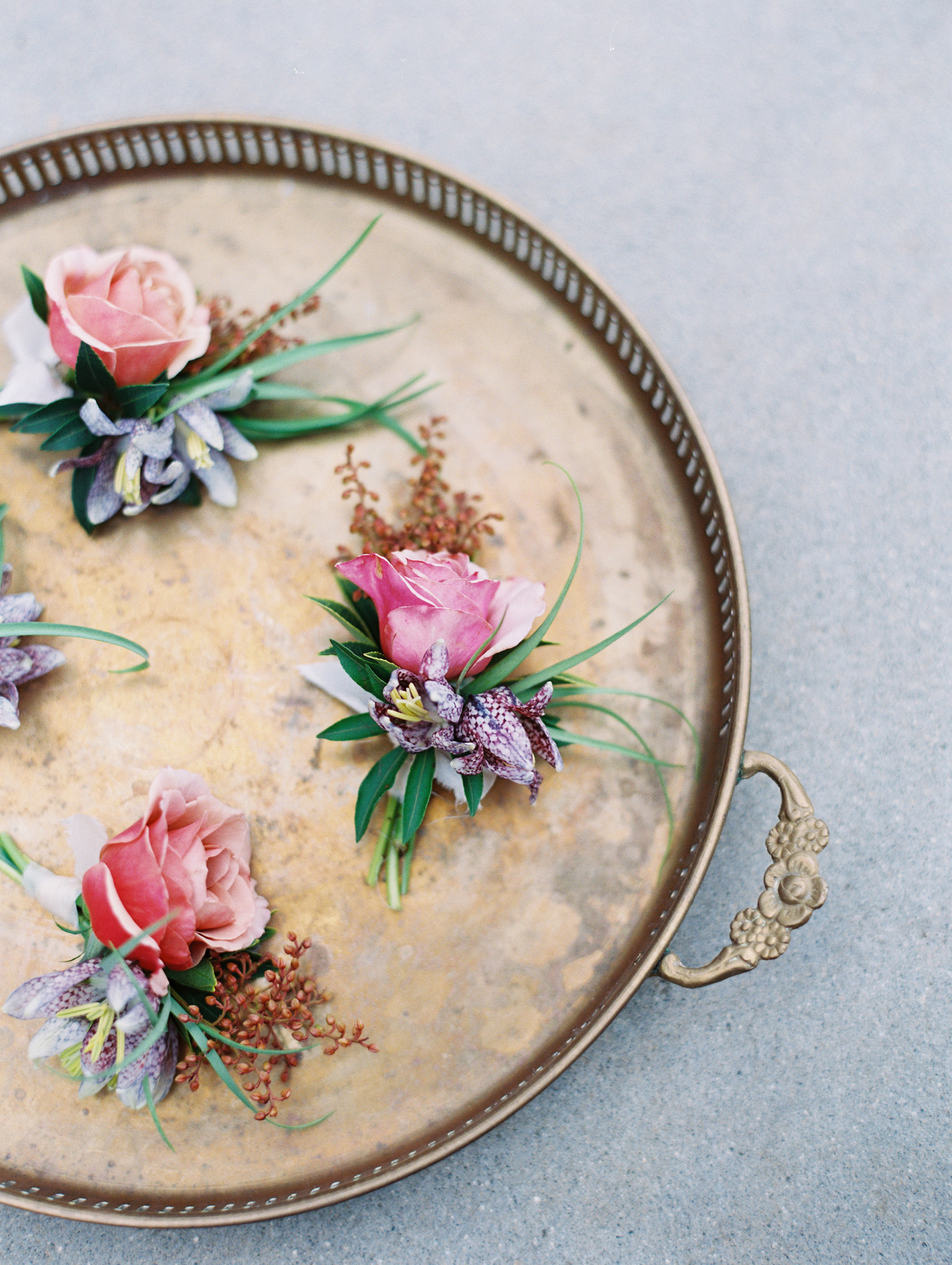 surprise wedding boutonnieres on tray