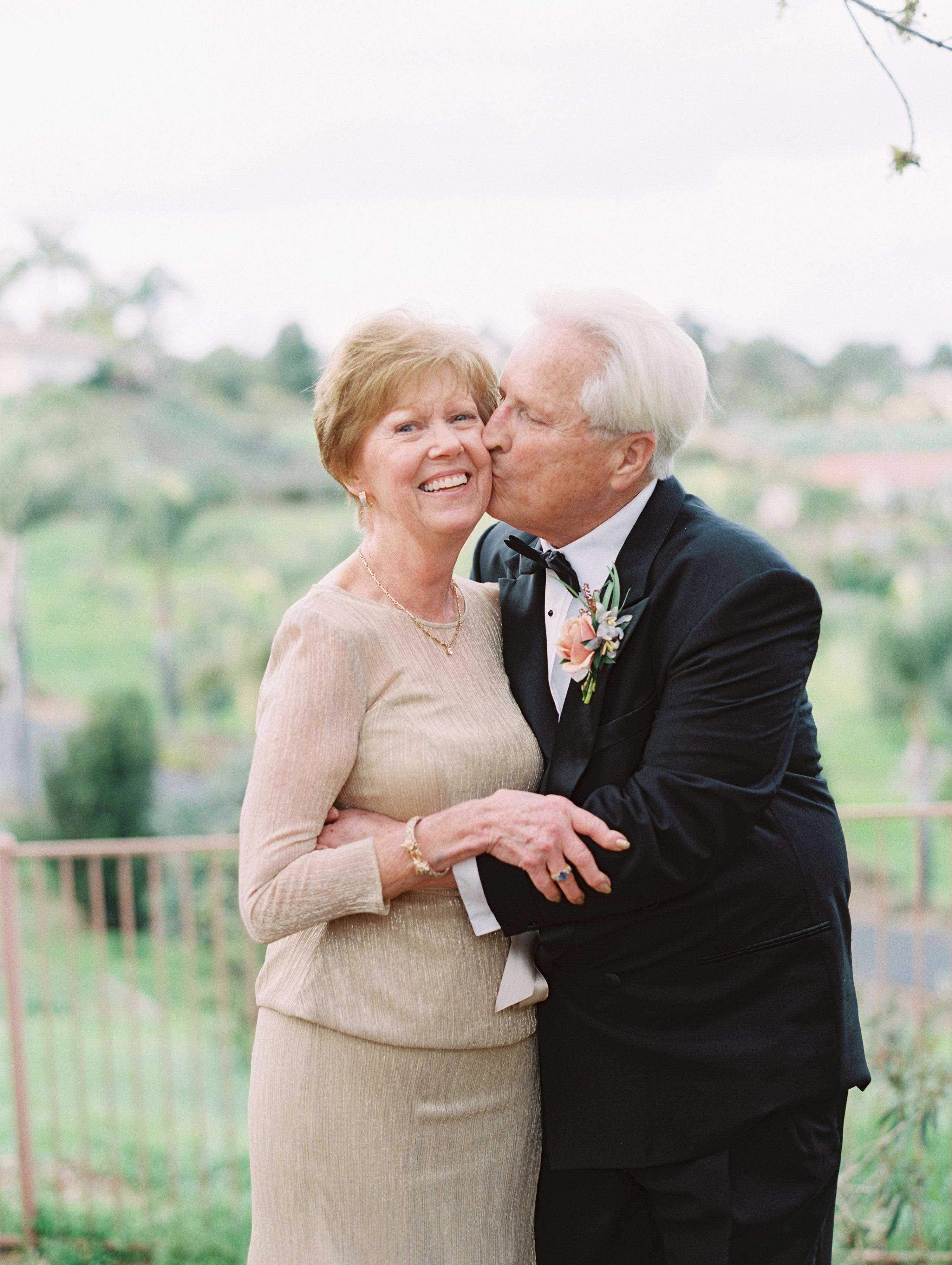 surprise wedding parents kiss on cheek