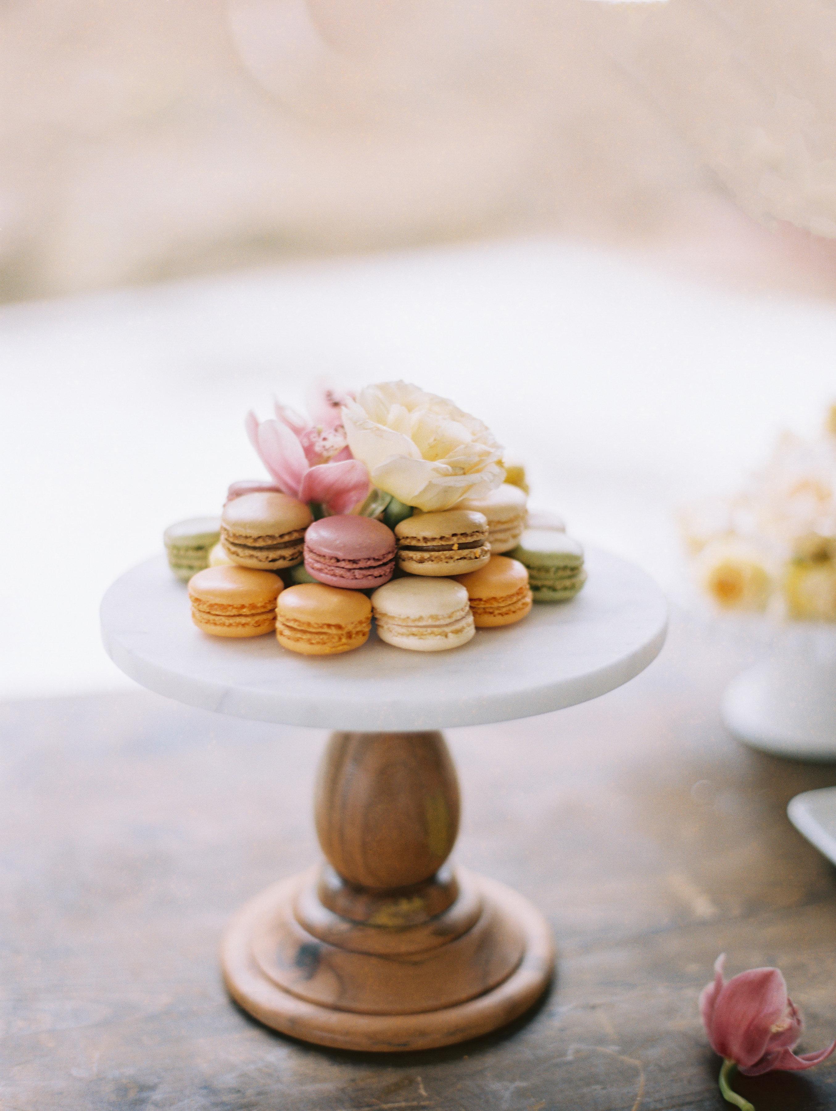 surprise wedding macarons arranged cake stand