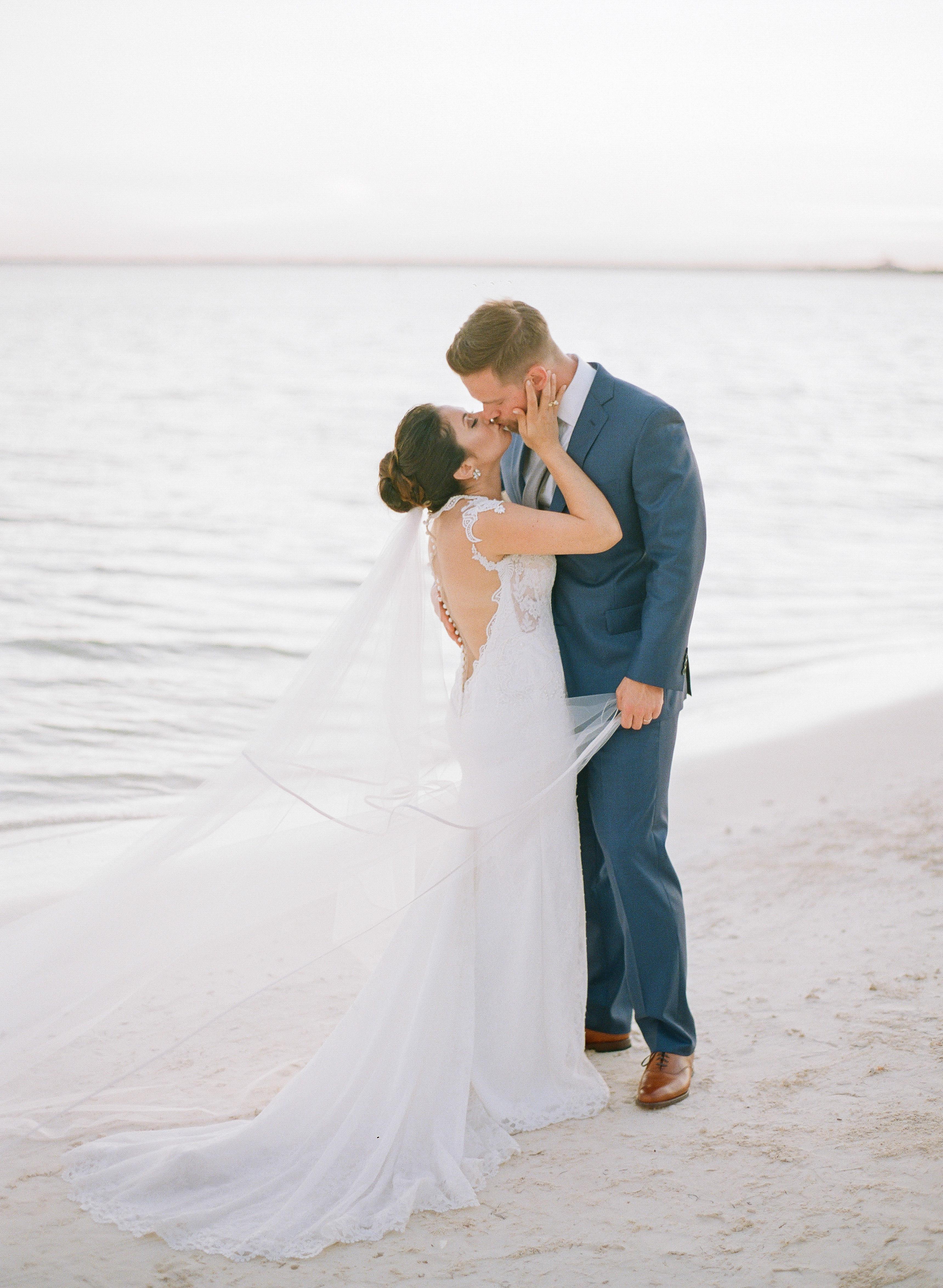 vicky james mexico wedding bride groom beach kiss