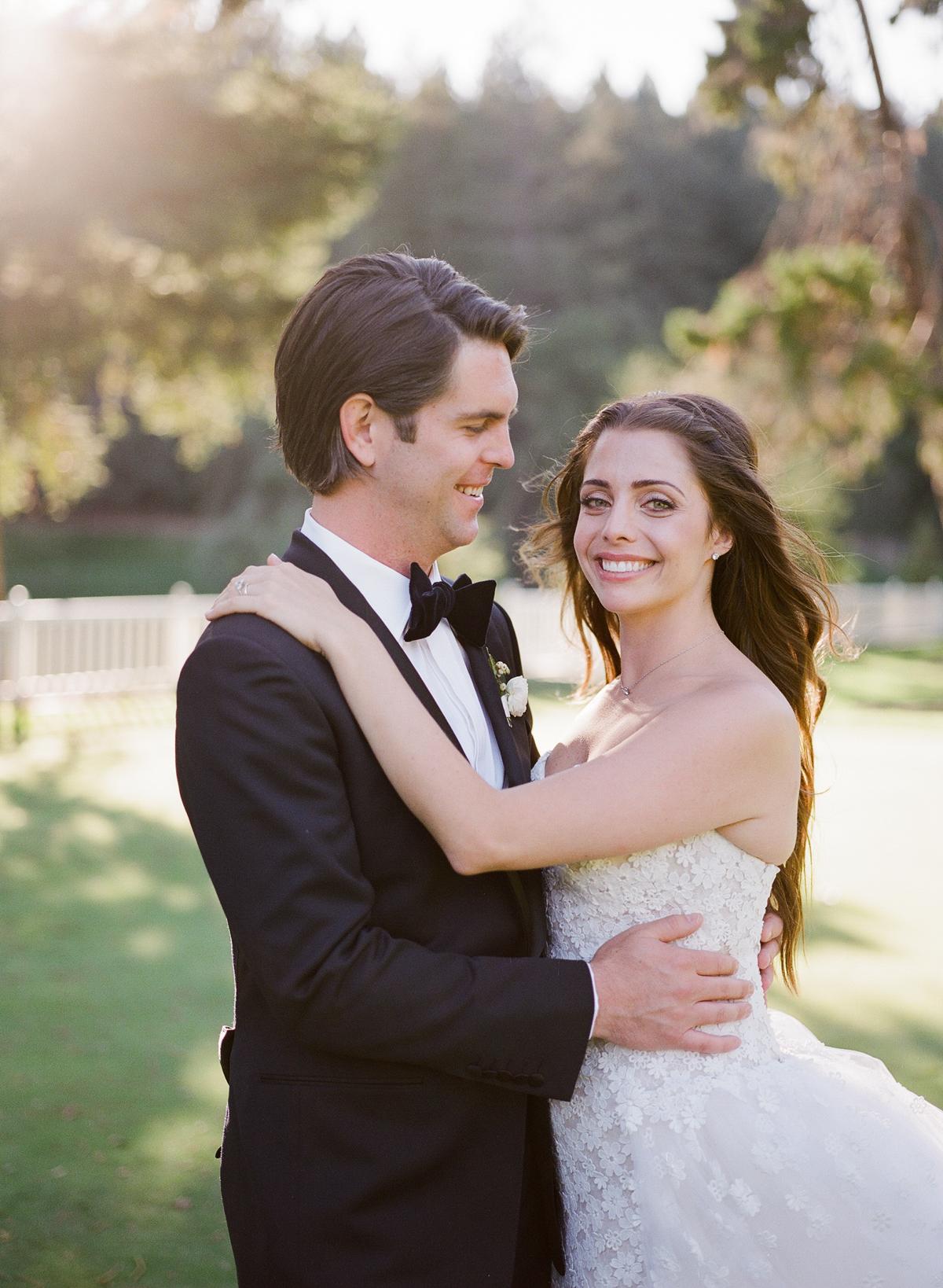 alessa andrew wedding groom smiling at bride