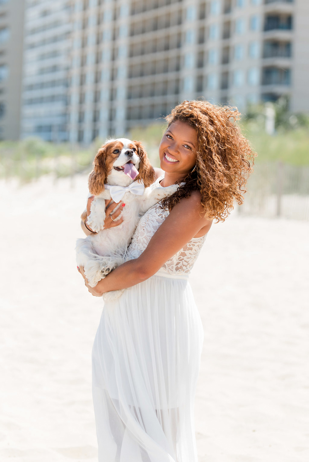 woman holding dog with white bow tie
