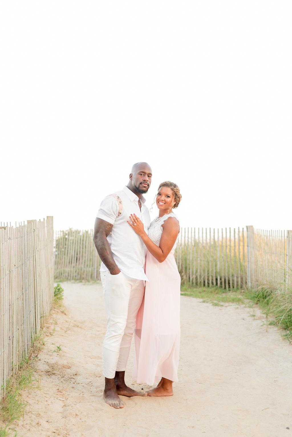 couple posing on sand path