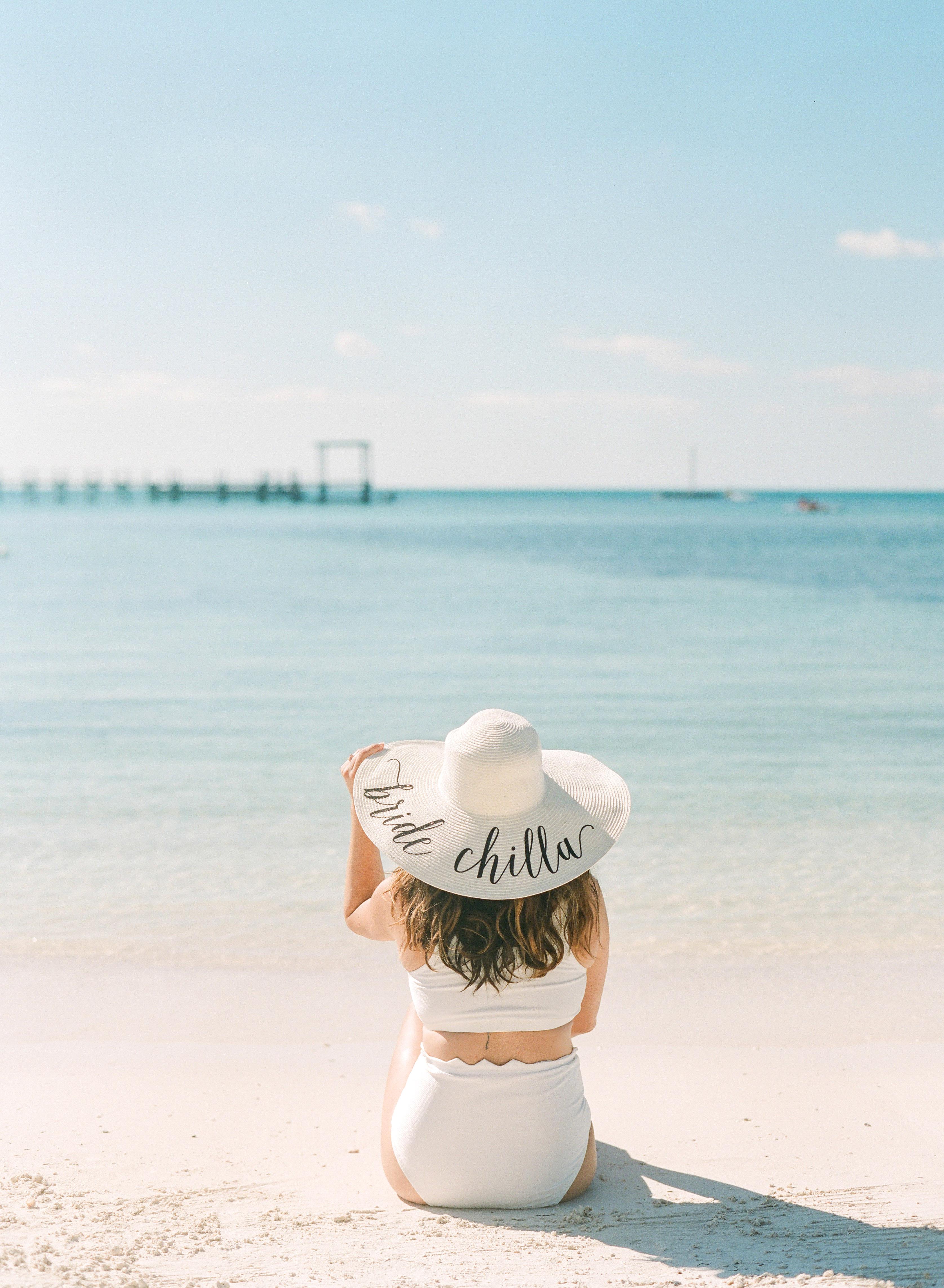 woman wearing bride chilla straw hat on beach