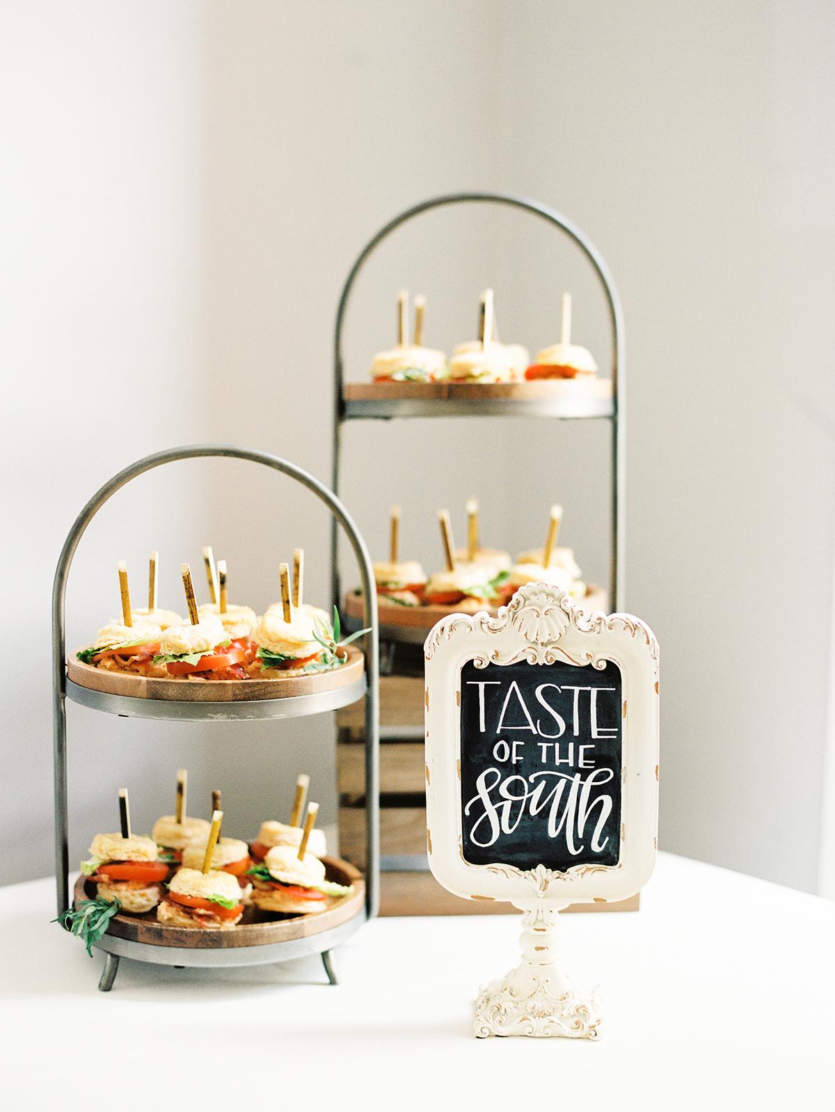 appetizer sandwiches on dessert stands
