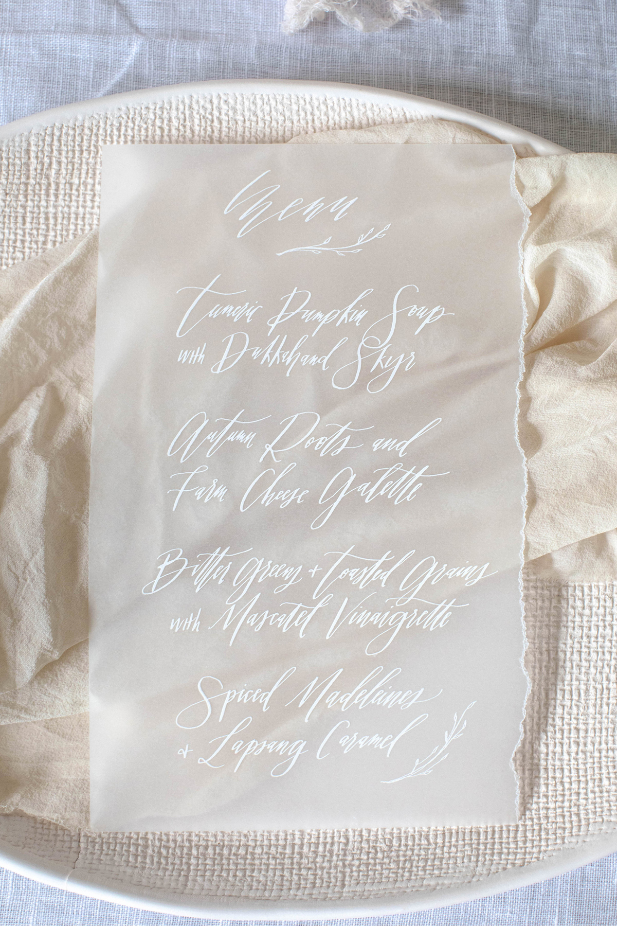 vellum menu with calligraphy and torn edge