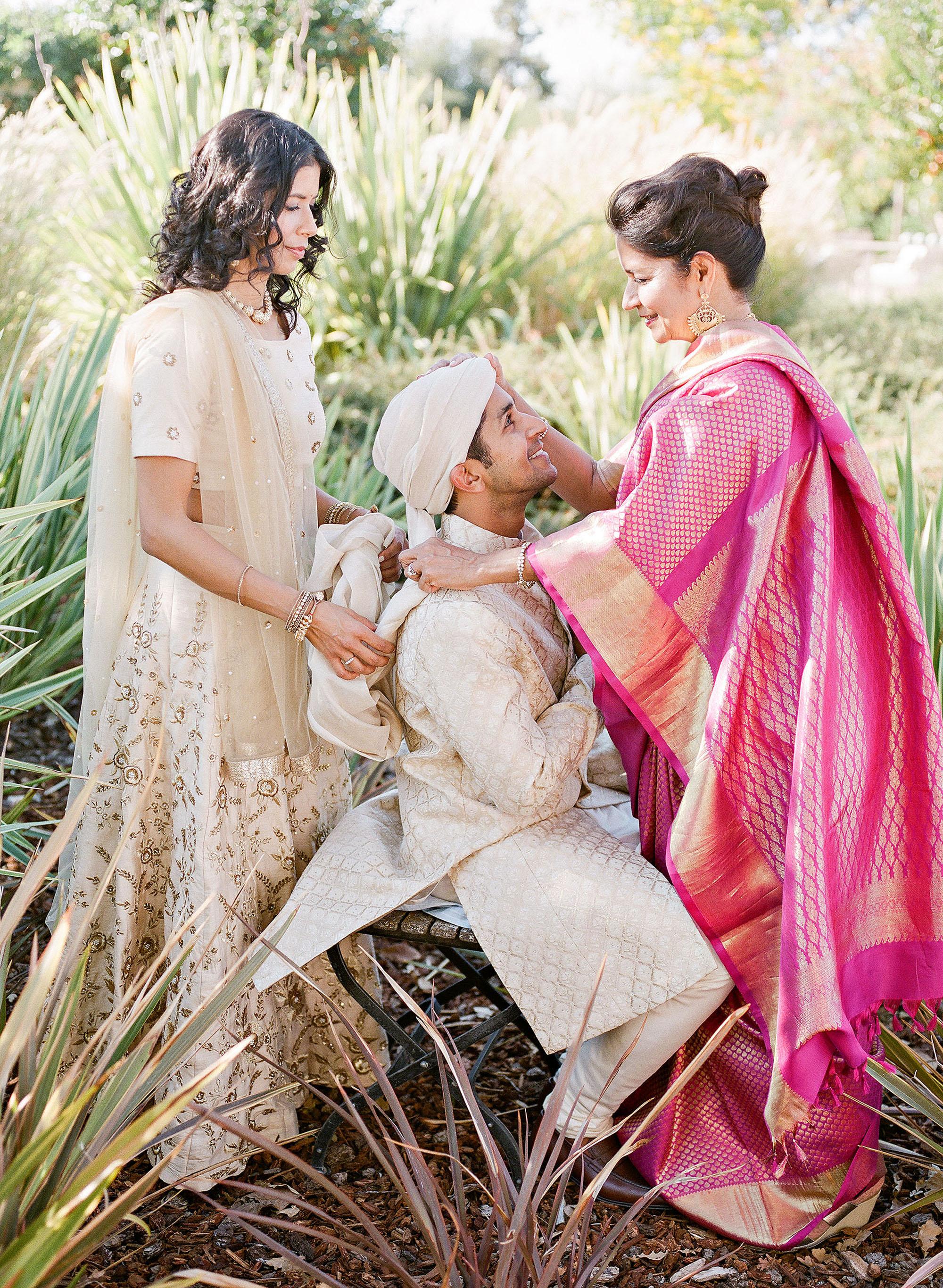 jenna alok wedding wine country california mother sister tying groom turban