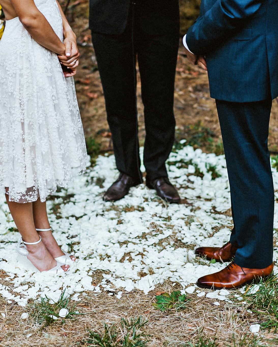 amy nick wedding ceremony petals feet