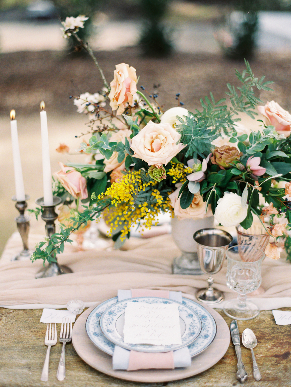 compote centerpieces pink roses and pale pink table setting