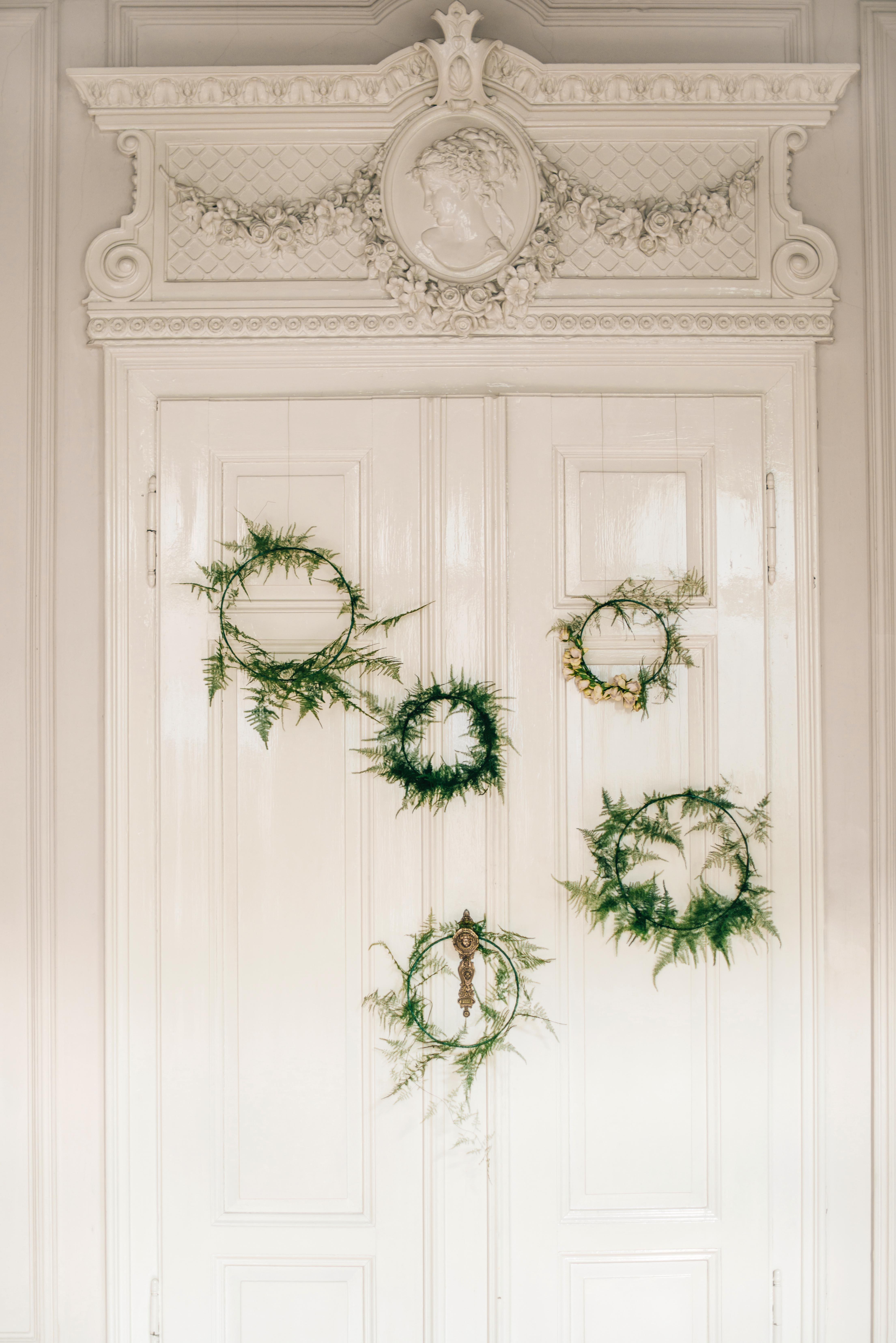 winter rehearsal dinner wreath decor doorway
