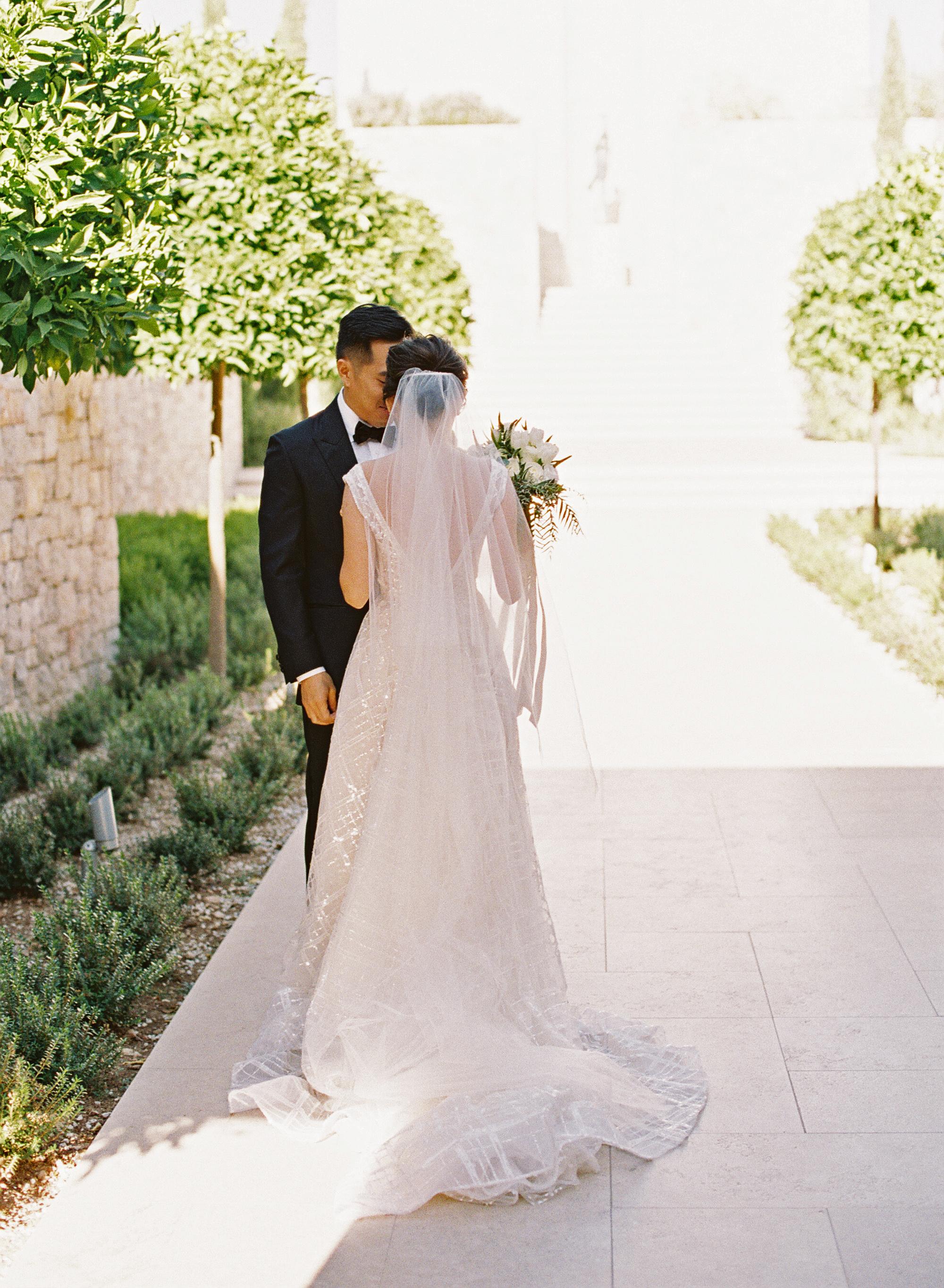 sze amanzoe wedding first look greece elegant