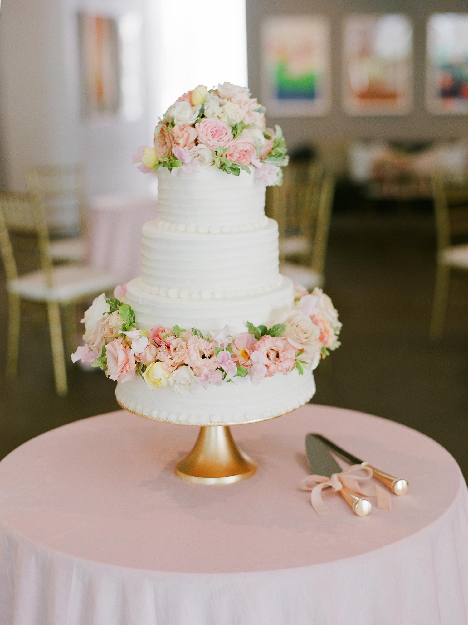 anwuli patrick wedding pastel cake on golden stand