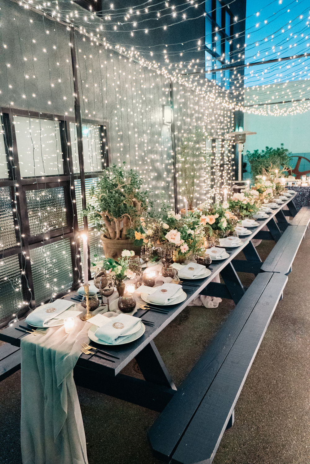twinkle lights against wall and above reception tables