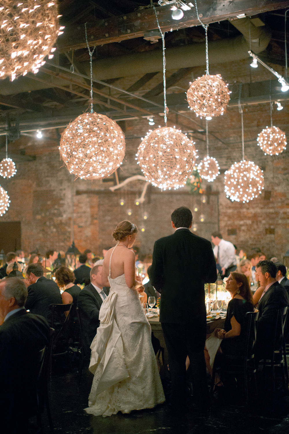 twinkle lights orbs above reception tables