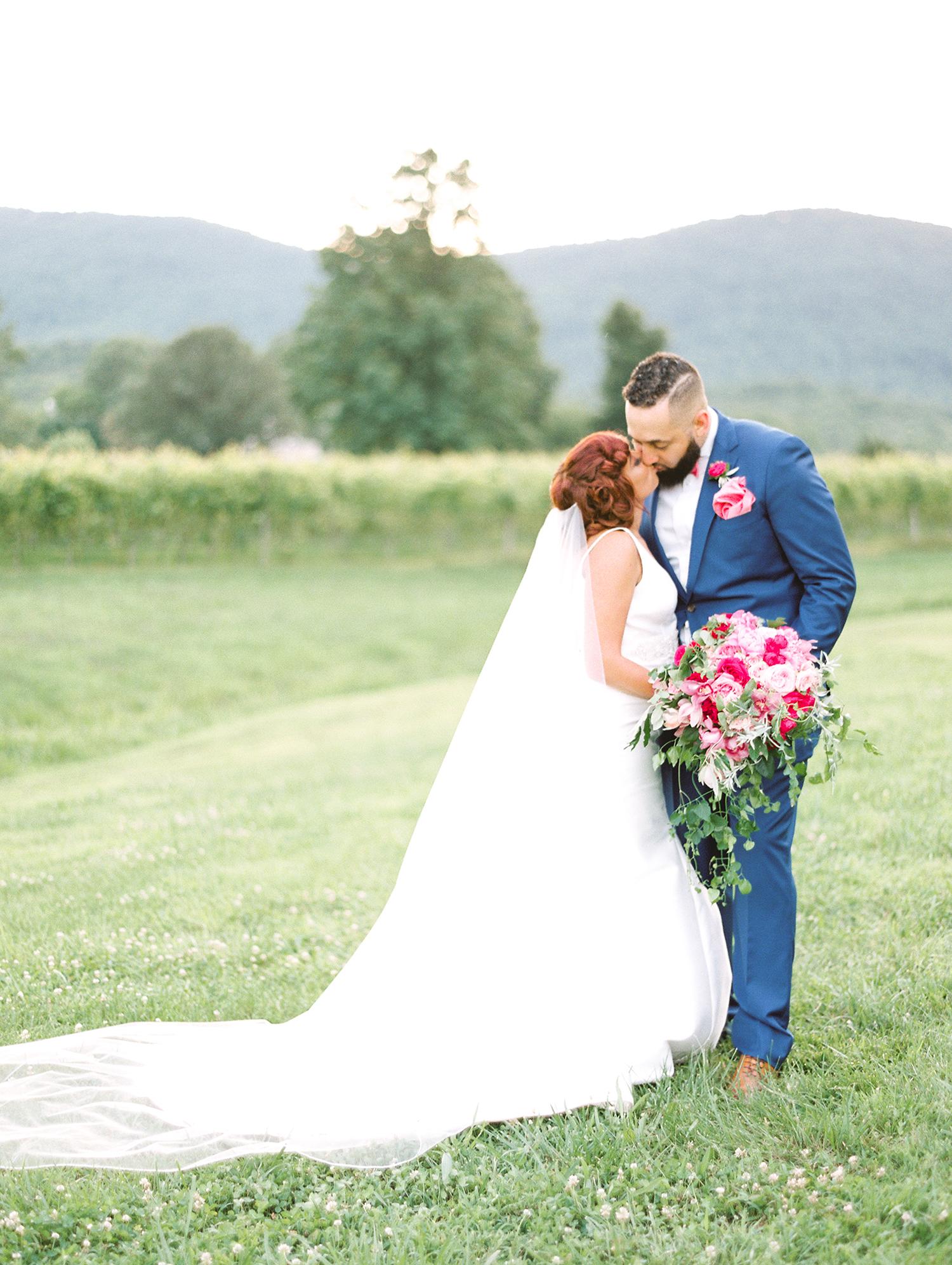 dawn rich wedding couple kissing in field