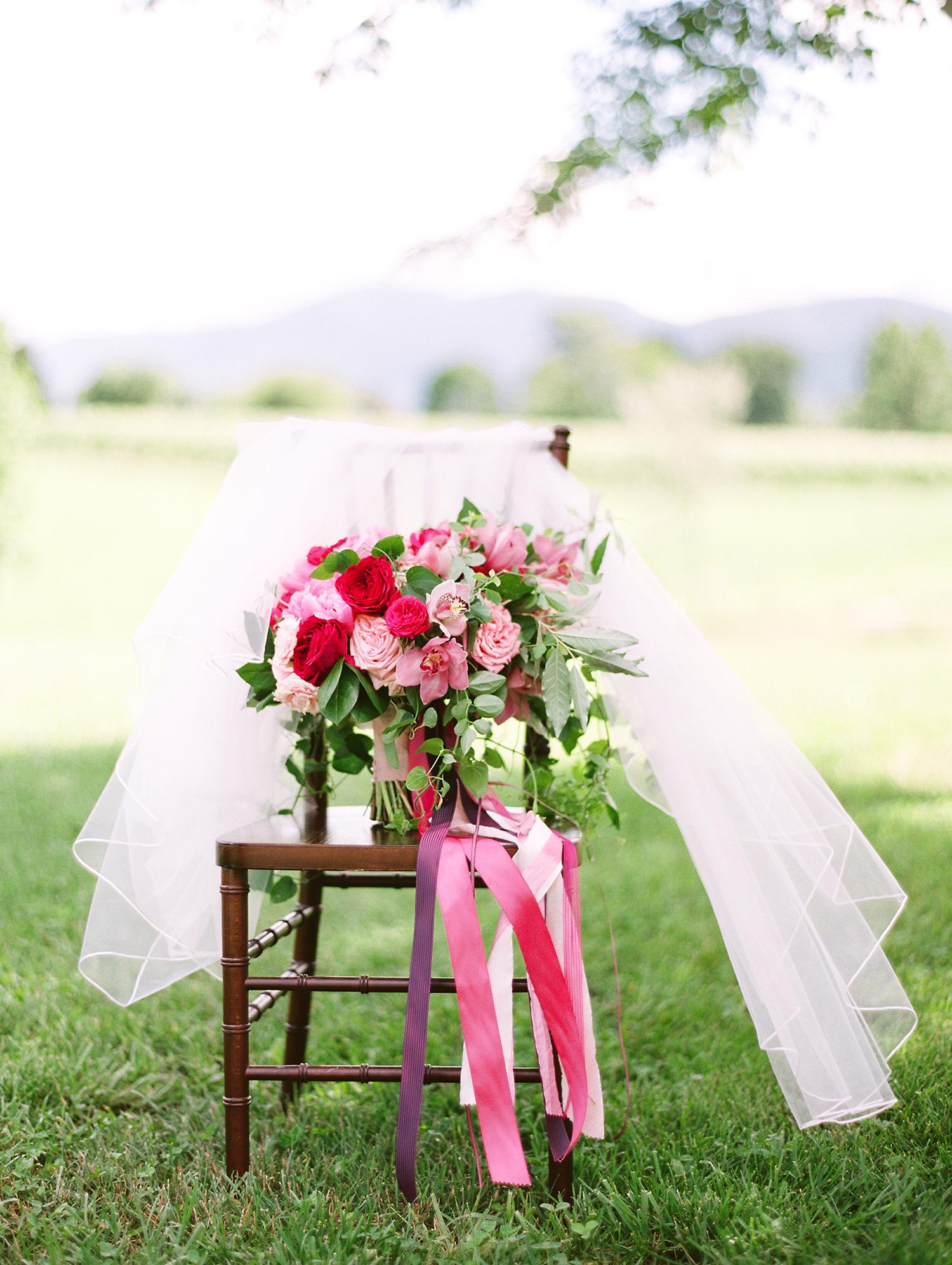 dawn rich wedding pink bouquet on chair in the grass